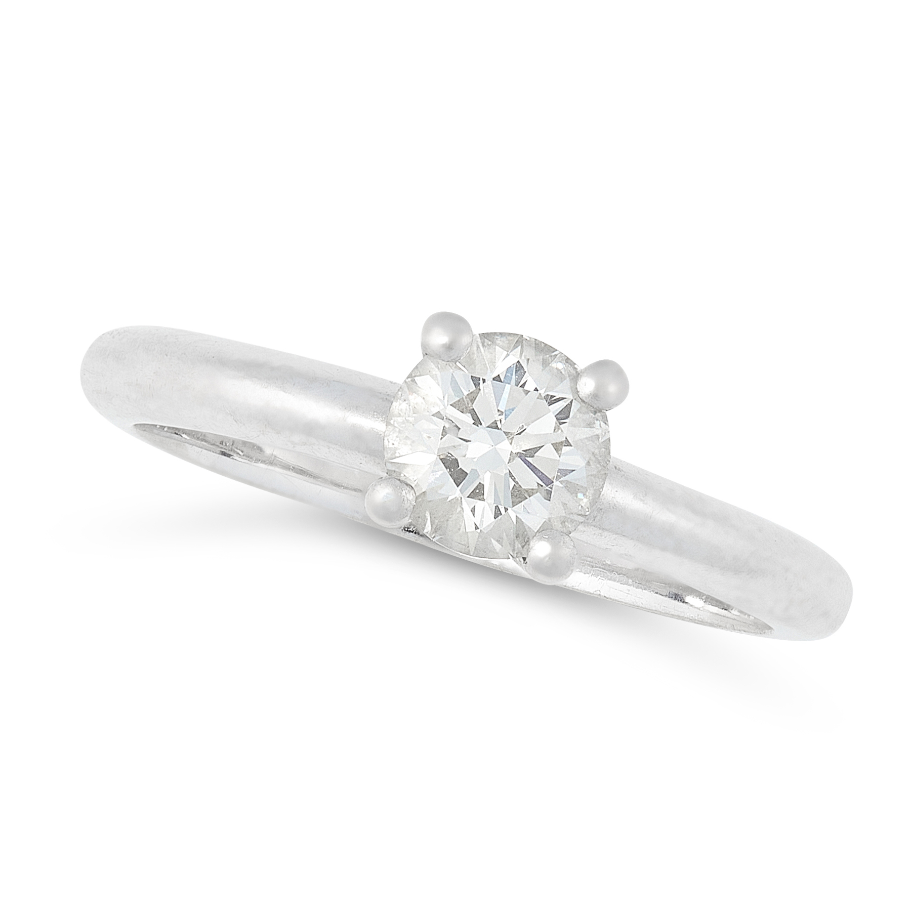 A DIAMOND SOLITAIRE RING in platinum, set with a round cut diamond of 0.53 carats, full British