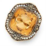 A CITRINE, PEARL AND ENAMEL RING in yellow gold, set with a cushion cut citrine within a border of