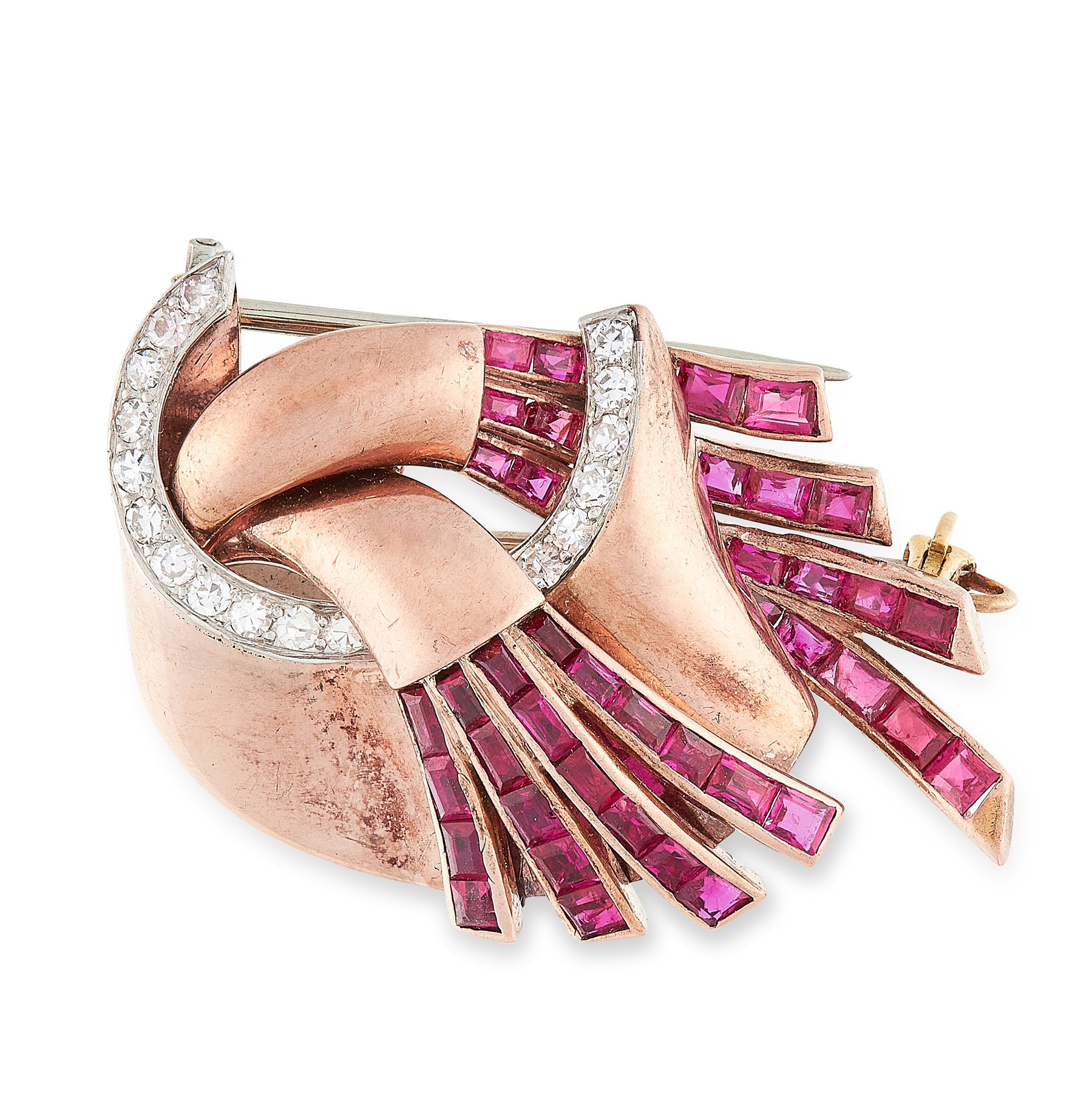 A RETRO RUBY AND DIAMOND BROOCH, CIRCA 1940 in 18ct rose gold, of scrolling design, set with rows of