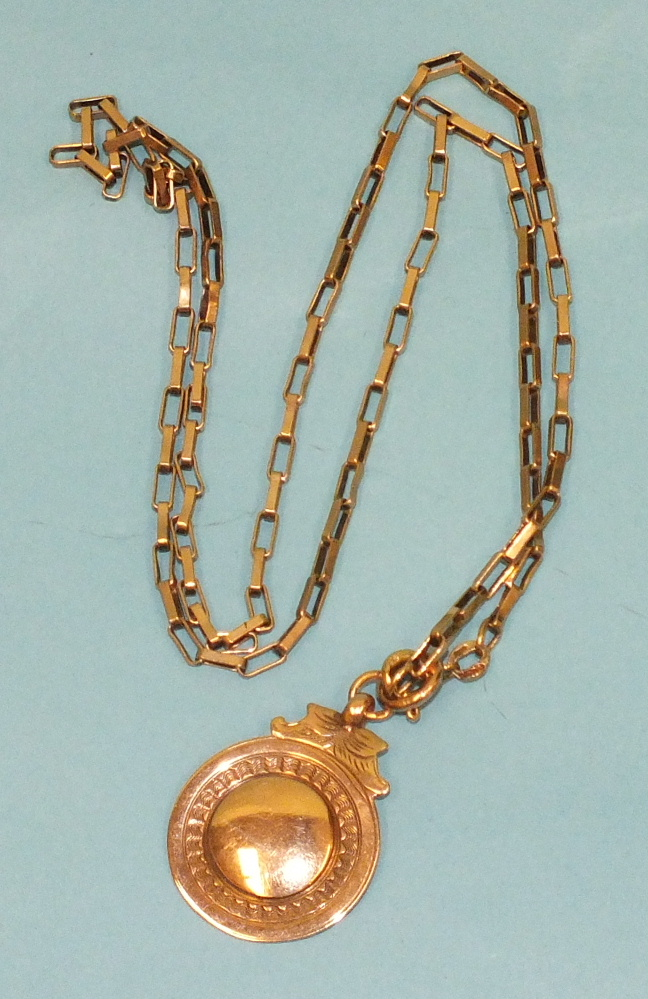 Lot 141 - A 9ct rose gold medallion on a 9ct gold rectangular-linked chain, 11.6g.