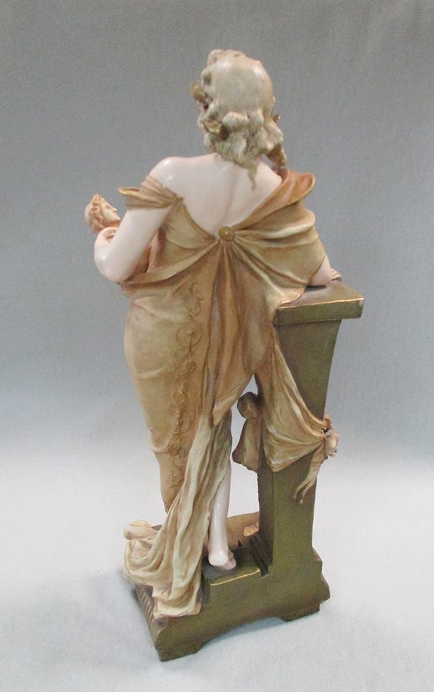 Lot 31 - Ernst Wahliss (Austrian 1837-1900), an Art Nouveau pottery figure of a pretty young woman,