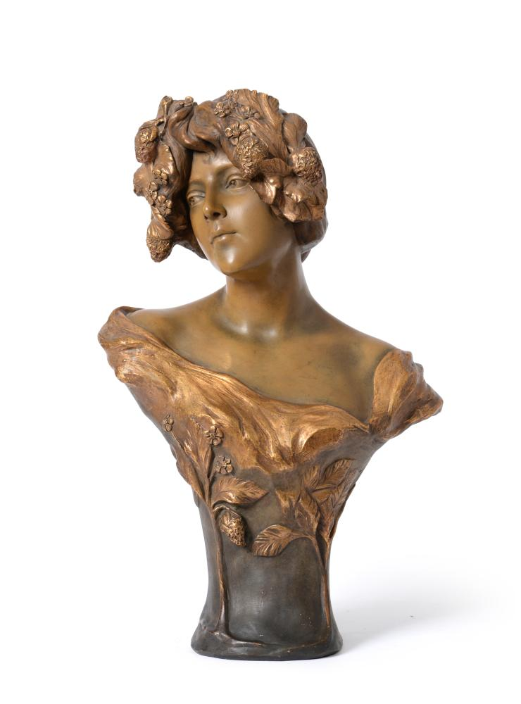 Lot 35 - Cherc for Goldscheider, an Art Nouveau cold painted terracotta bust of a maiden, with a garland of