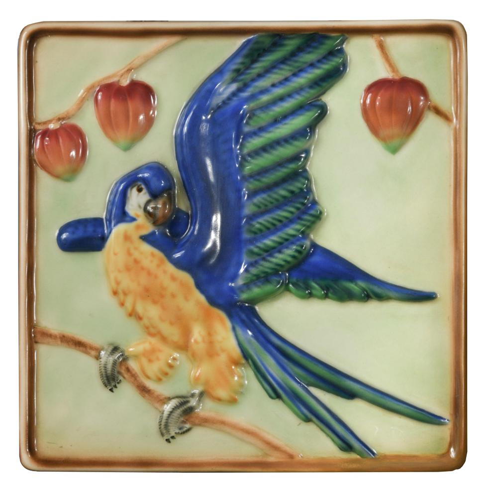 Lot 62 - A Goldscheider Pottery plaque depicting a Parrot, the square plaque painted in colours, printed