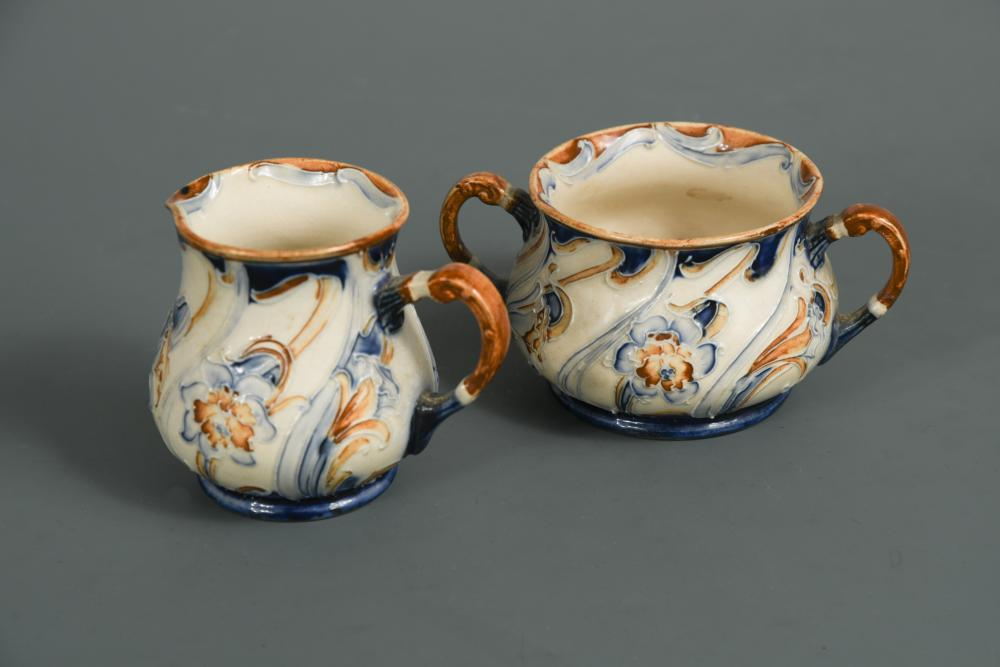 Lot 39 - A MacIntyre Moorcroft Florian Ware milk jug and sugar bowl, decorated in an unusual Daffodil