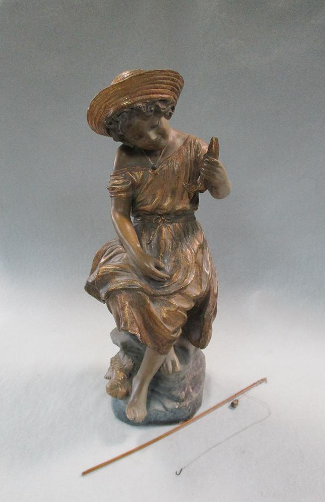 Lot 37 - A Goldscheider terracotta model of a young girl fishing, she sits perched upon a rock holding her