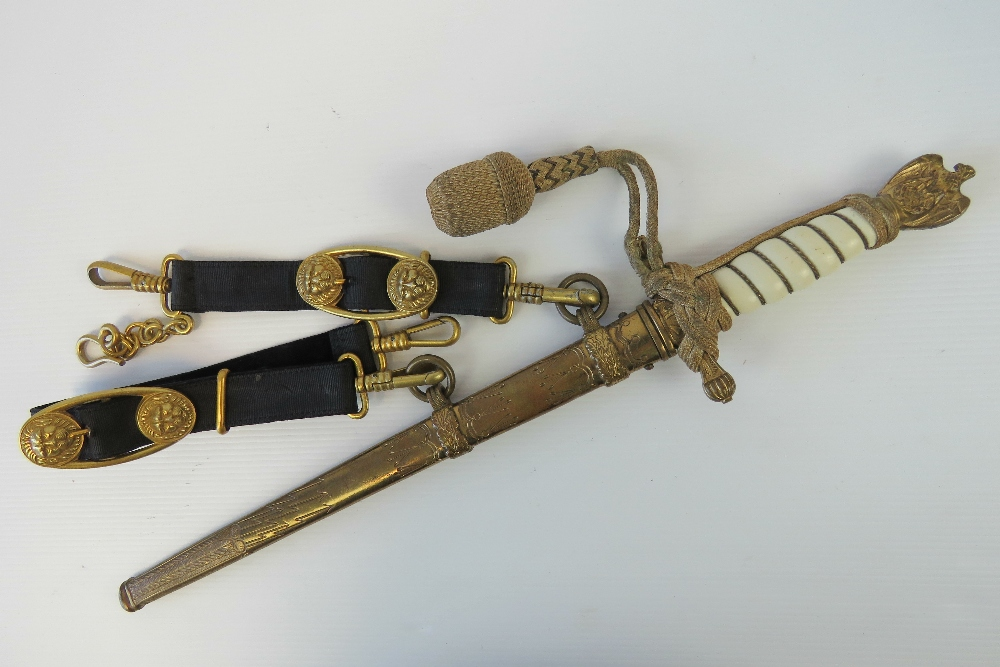 Lot 28 - A WWII German Kreigsmarine dagger with etched blade complete with original hangers,