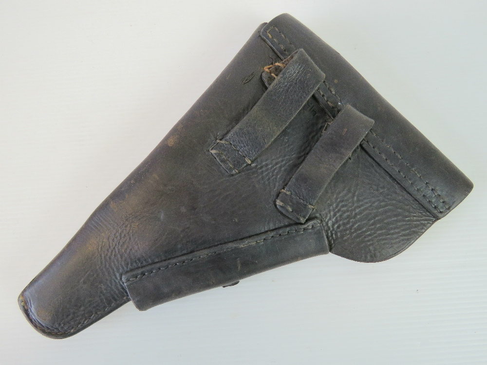 Lot 45 - A WWII German Officers Walther P38 black leather pistol holster,