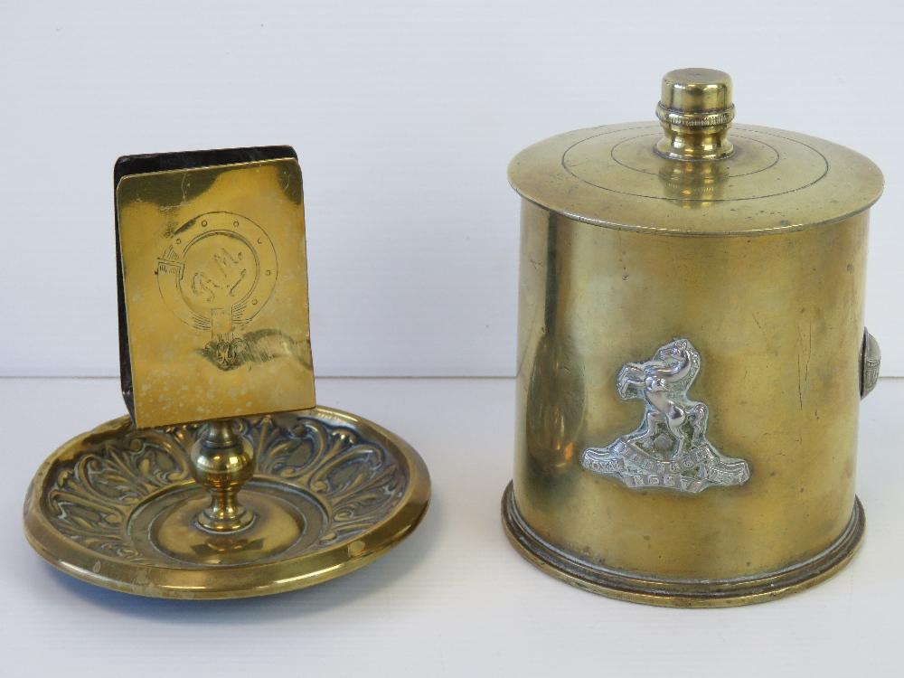Lot 50 - Two pieces of trench art; a matchbox holder complete with repoussé smokers receptacle under,