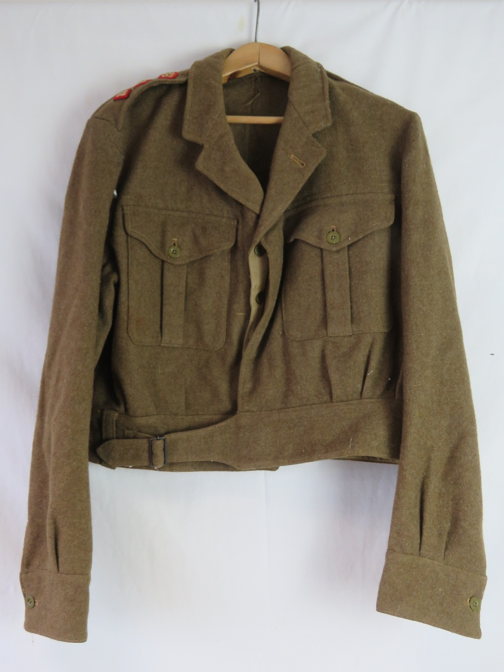 Lot 43 - Four British Military tops/shirts some with insignia and rankings. National service era.