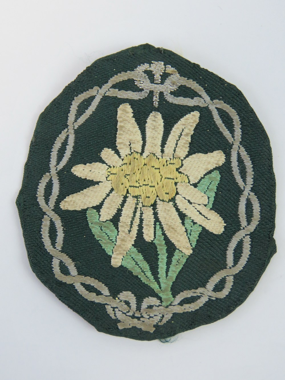 Lot 30 - A WWII German Wehrmacht Mountain Troops Edelweiss cloth badge.