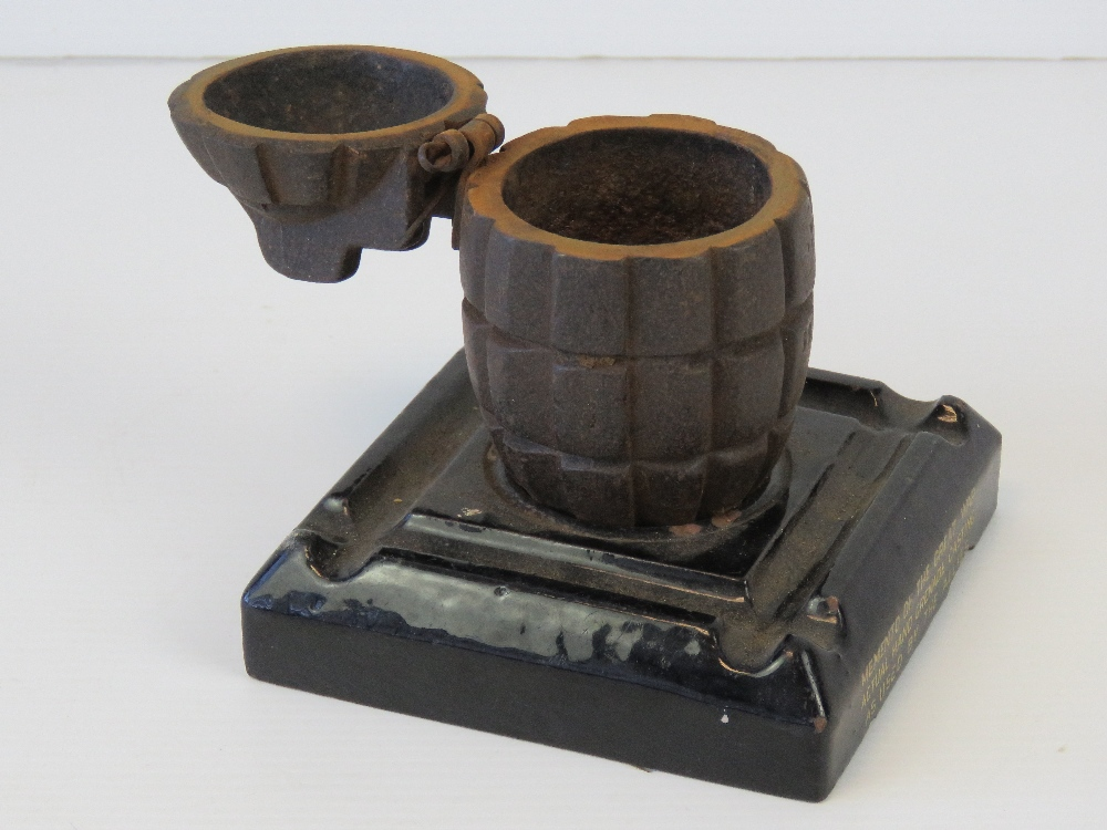 Lot 18 - A WWI Mills Grenade casting converted into a match pot, raised over smokers receptacle base,