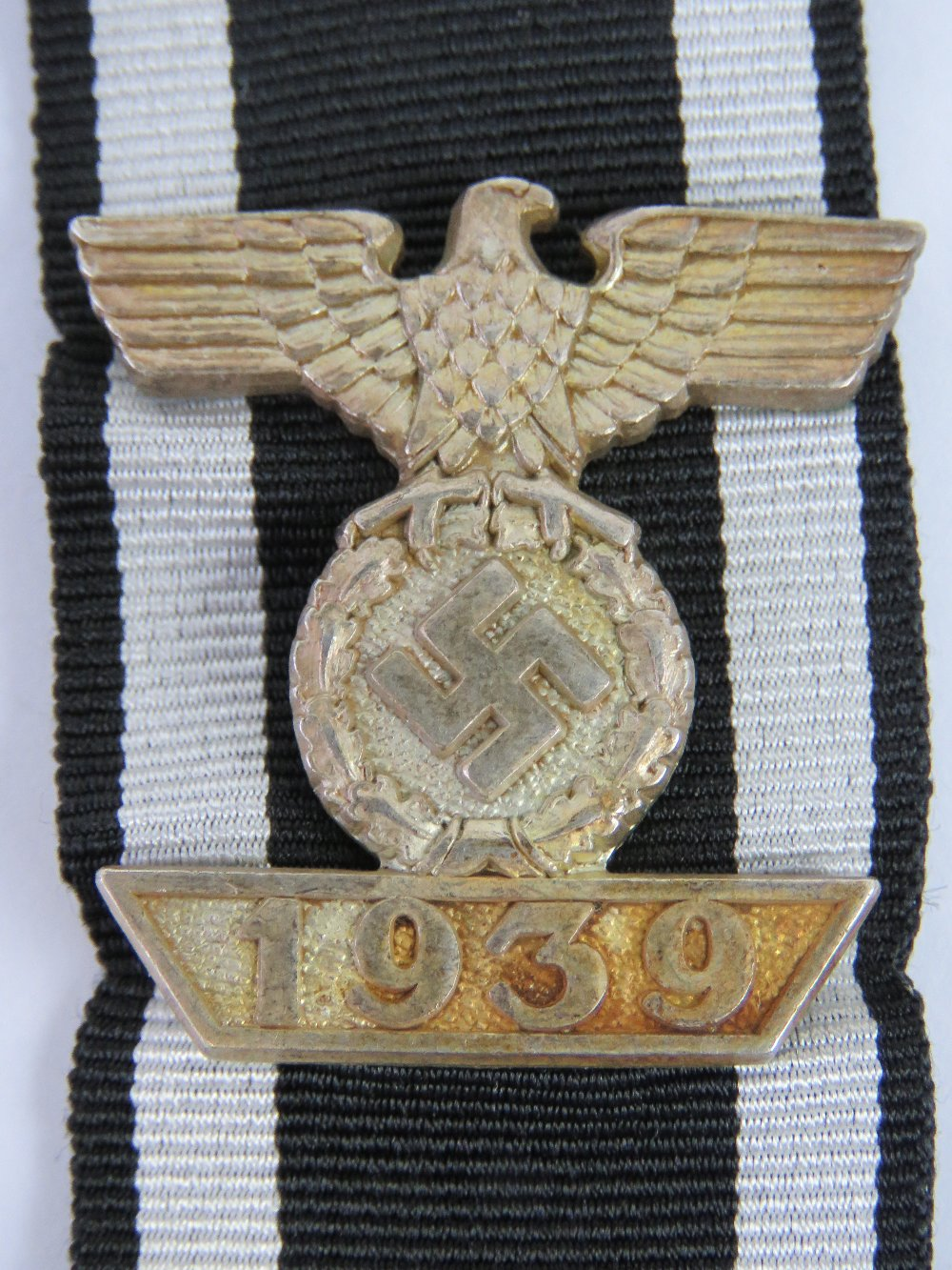 Lot 33 - A WWII German Iron Cross 2nd Class bar with box and ribbon.