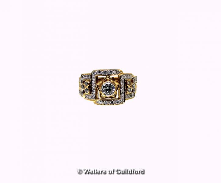 Lot 5101 - Diamond cluster dress ring, central round brilliant cut diamond, weighing an estimated 0.50ct,