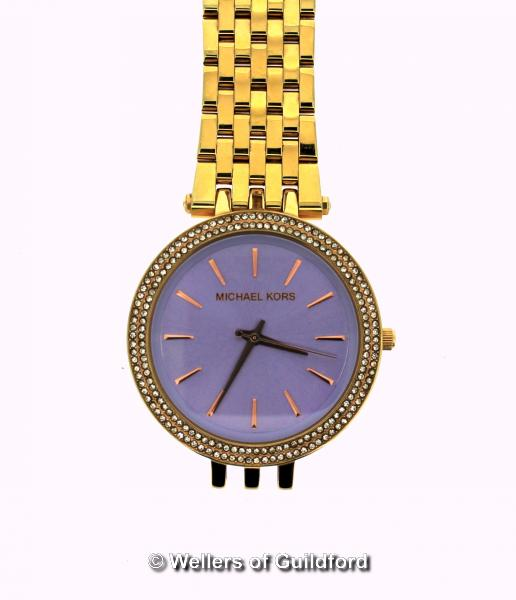 Lot 5019 - *Ladies' Michael Kors wristwatch, circular mauve dial with white stone set bezel and baton hour