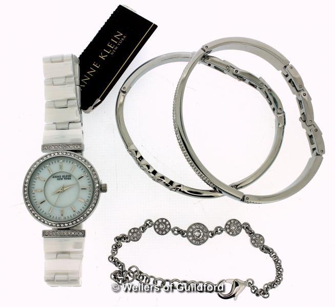 Lot 5044 - *Ladies' Anne Klein wristwatch, circular white dial with white stone set bezel, white strap,