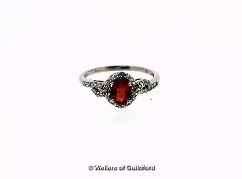 Lot 5111 - Orange kyanite and white zircon cluster ring, oval cut orange kyanite, weighing an estimated 0.32ct,