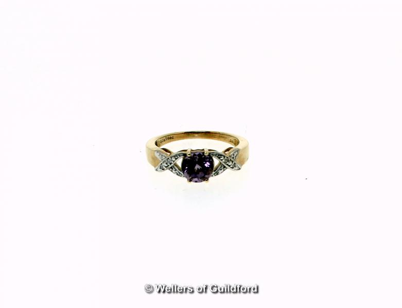 Lot 5106 - Purple spinel and diamond ring, oval cut purple spinel, weighing an estimated 1.07cts, with