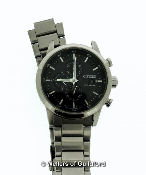 Lot 5007 - *Gentlemen's Citizen Eco-Drive wristwatch, circular black dial with baton hour markers, date