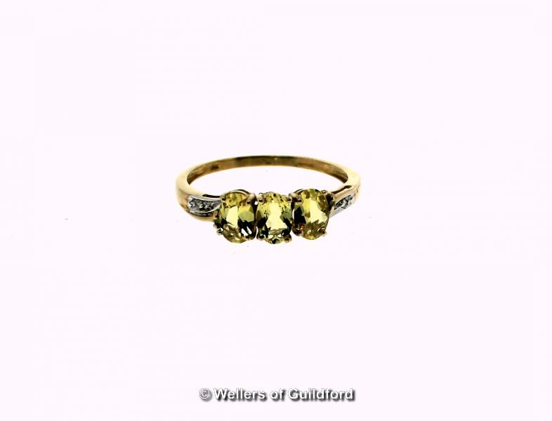 Lot 5110 - Yellow scapolite and diamond ring, three oval cut yellow scapolites, weighing an estimated total