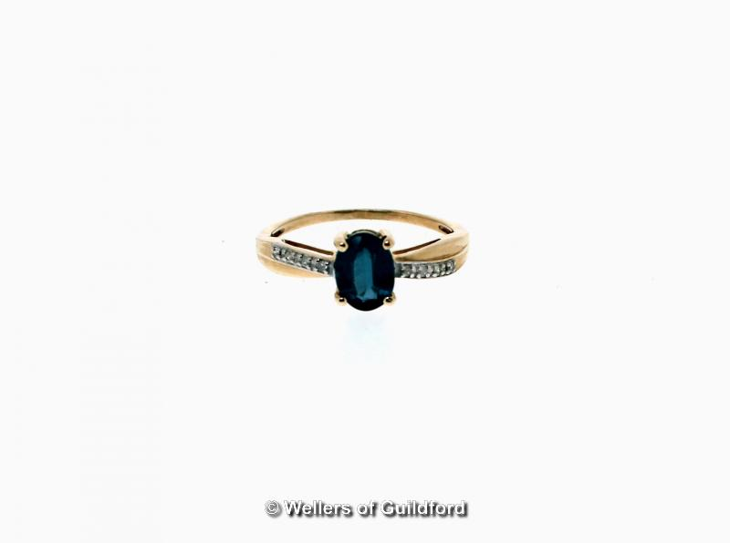 Lot 5108 - Kyanite and diamond ring, oval cut kyanite, weighing an estimated 1.17cts, with diamond set twist
