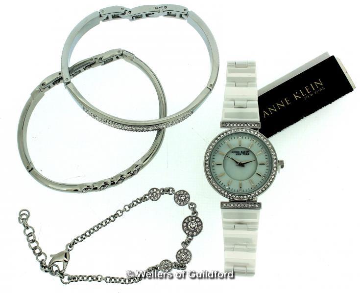 Lot 5043 - *Ladies' Anne Klein wristwatch, circular white dial with white stone set bezel, white strap,