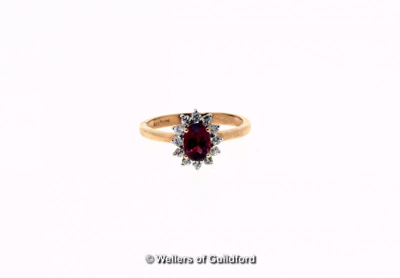 Lot 5104 - Rubellite and zircon cluster ring, oval cut rubellite, weighing an estimated 0.85ct, with a surround