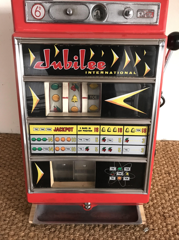 Lot 4 - A Jubilee International one armed bandit fruit machine, 66 cm