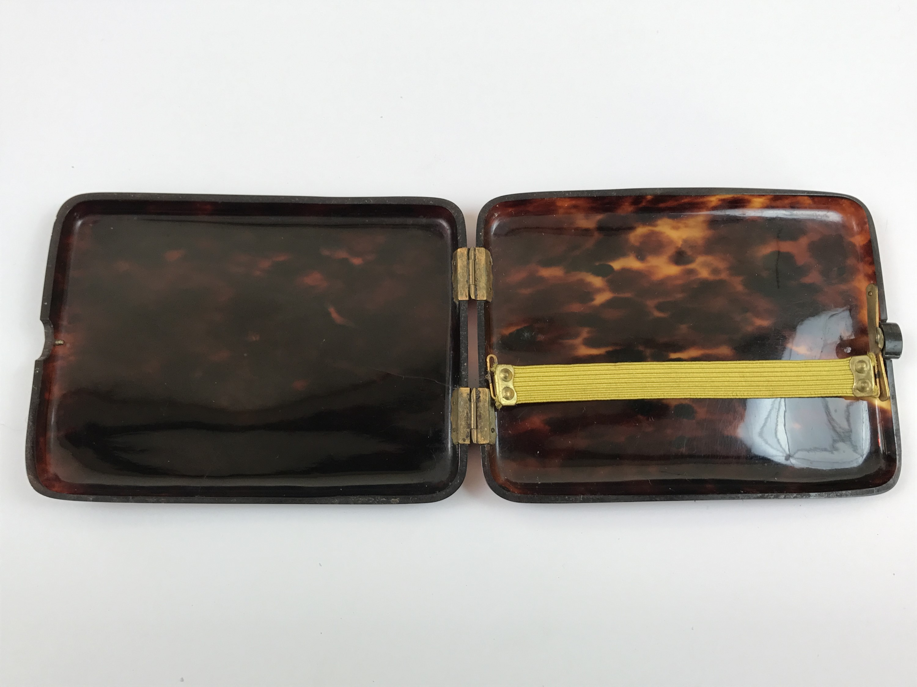 Lot 9 - A late 19th Century tortoiseshell cigarette case, with inset gilt metal monogram