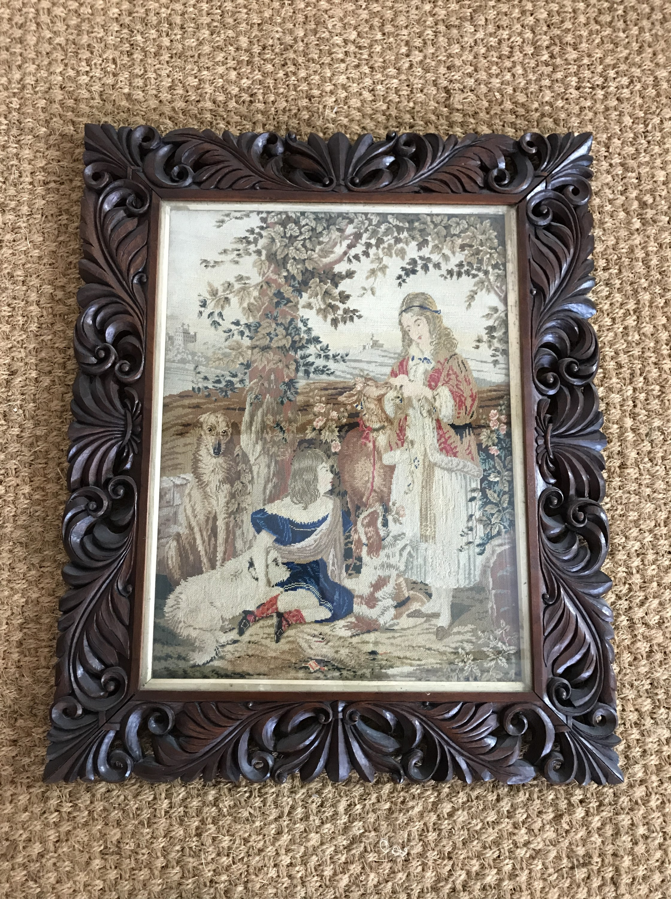 Lot 38 - A Victorian petit point tapestry embroidery of a sentimental scene, depicting children and dogs in a