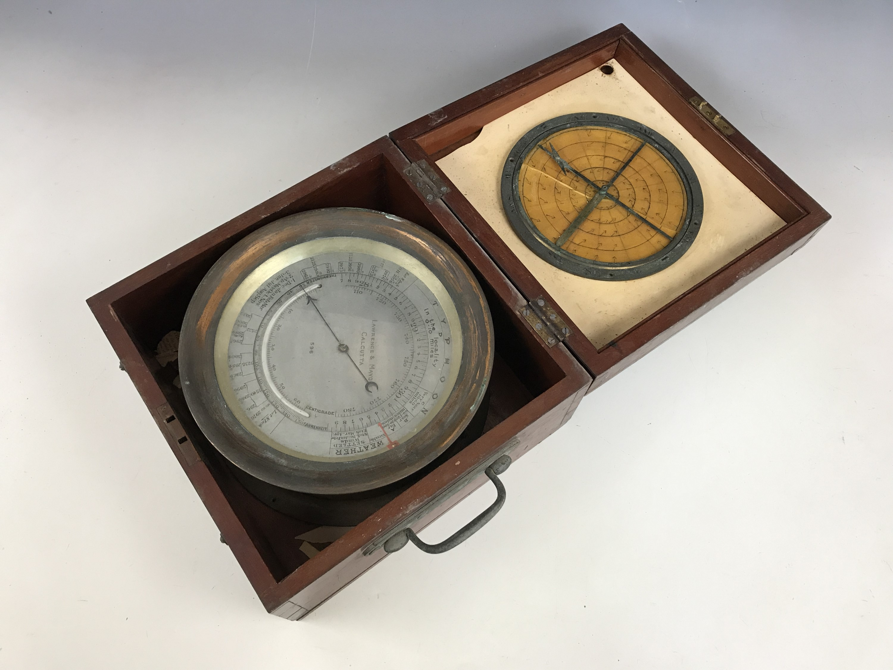 Lot 26 - A Victorian marine / ship's barometer and thermometer by Lawrence & Mayo of Calcutta, in mahogany
