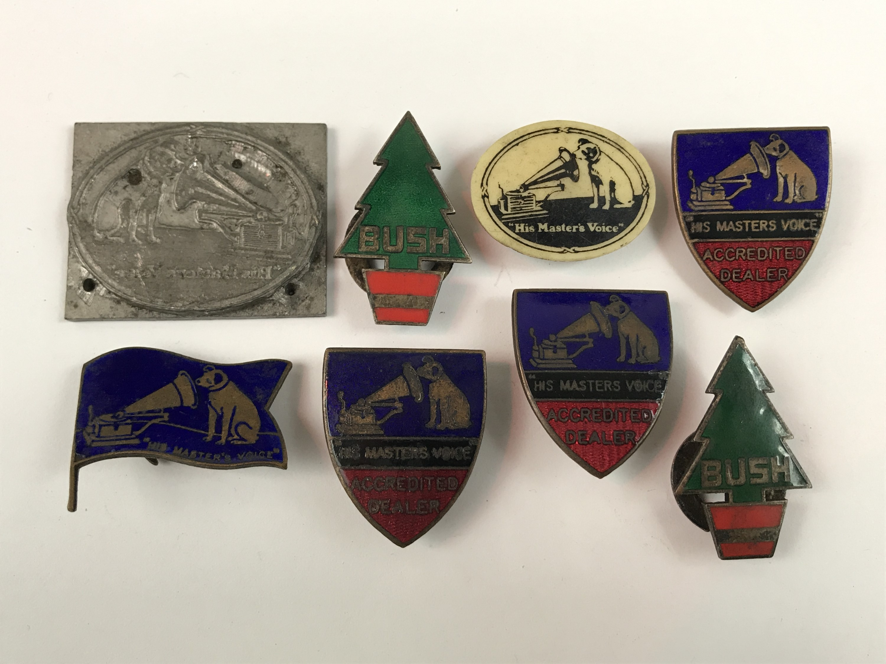 Lot 12 - [Gramophone] Six HMV and Bush 'Accredited Dealer' and promotional enamelled lapel badges, on other