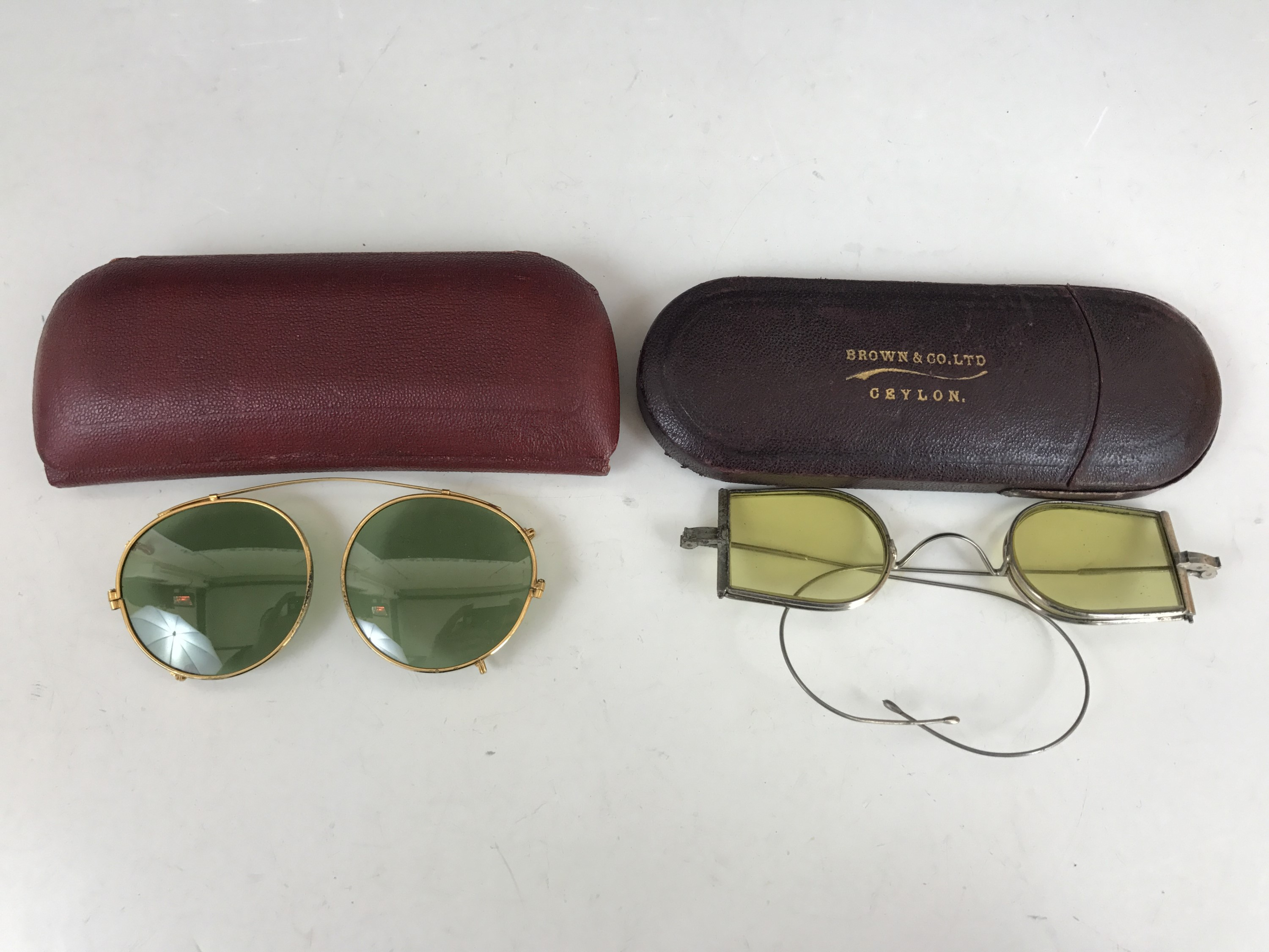 Lot 8 - A pair of late 19th Century folding sunglasses retailed by Brown & Co Ltd of Ceylon, in fitted case,
