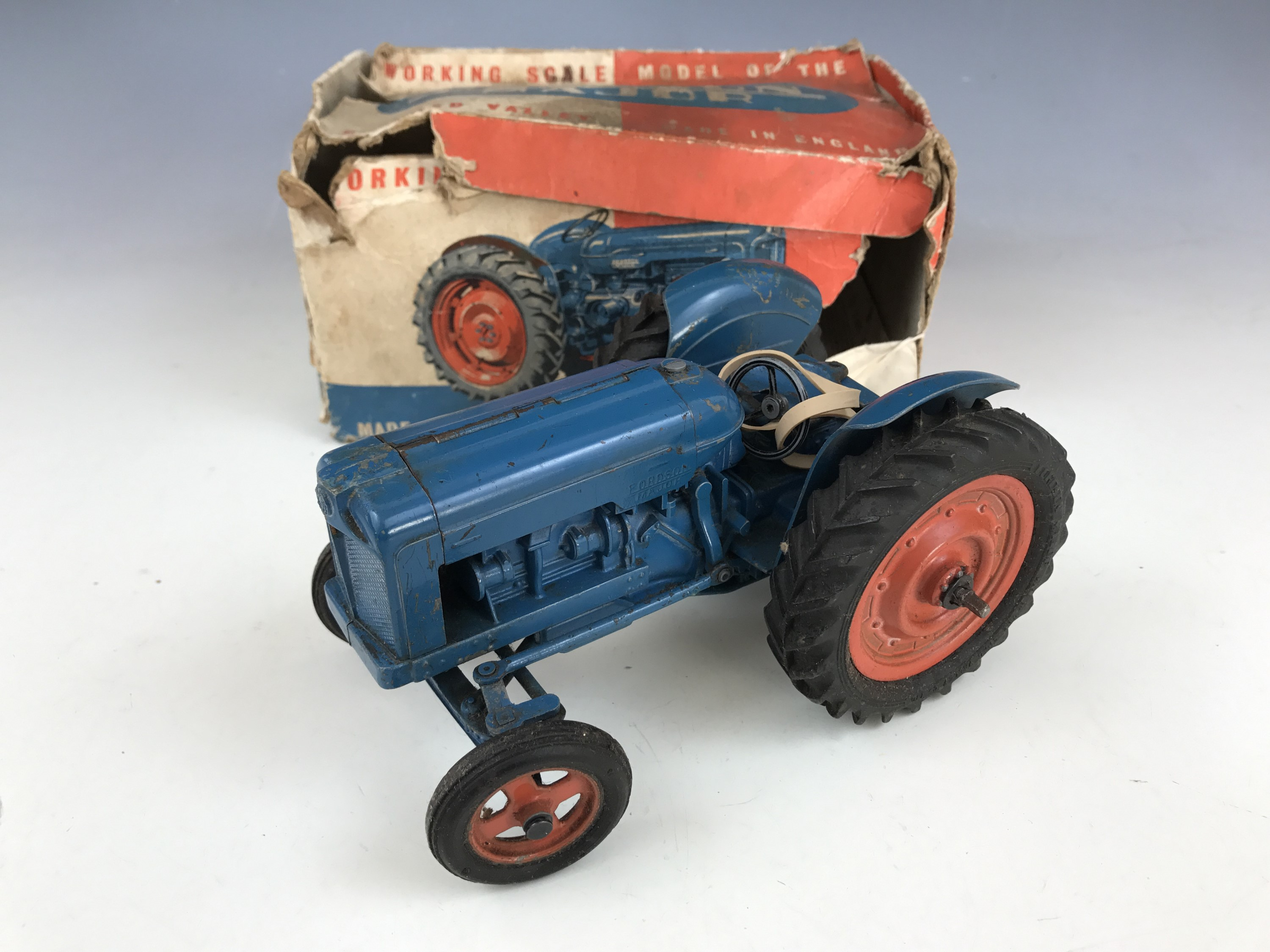 Lot 56 - A Chad Valley Co Ltd Working Scale Model of the New Fordson Major tractor, in petrol blue with red