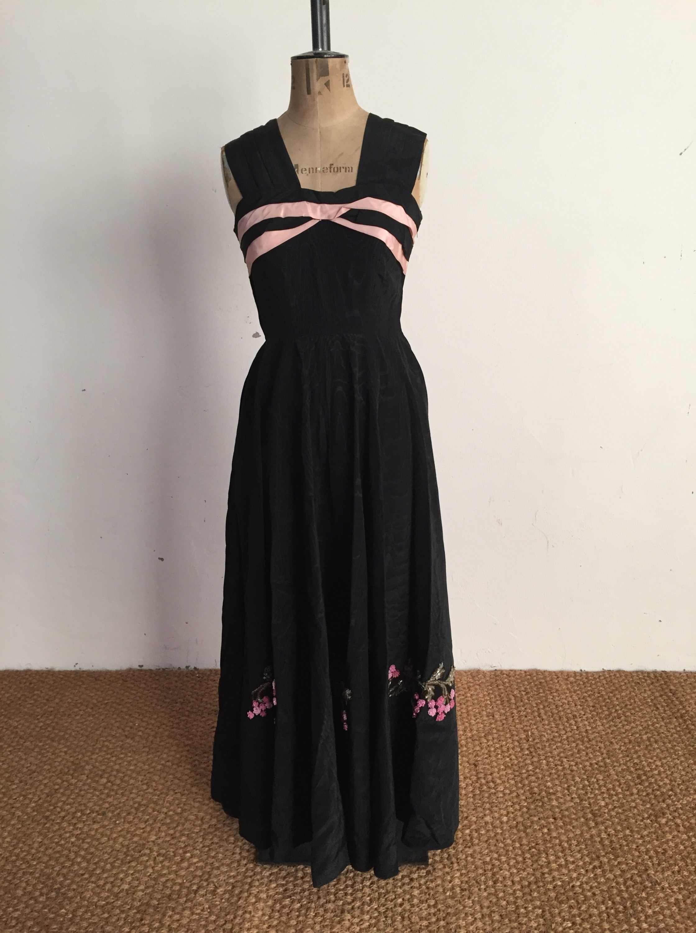 Lot 30 - A 1940s black moire evening dress, having broad gathered straps above a panelled bodice with