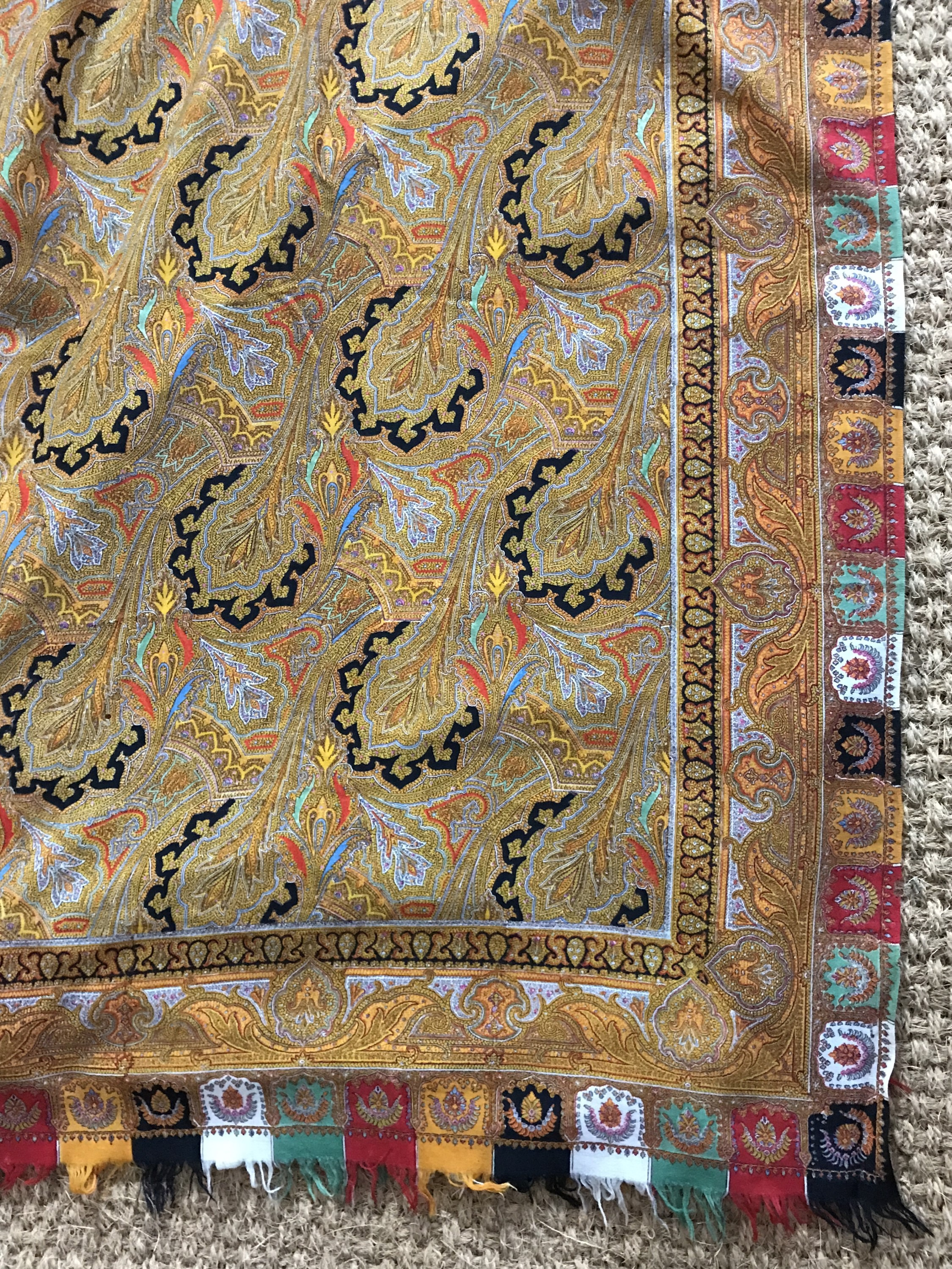 Lot 32 - A Victorian printed cotton paisley shawl, the ground densely decorated with golden botehs picked out