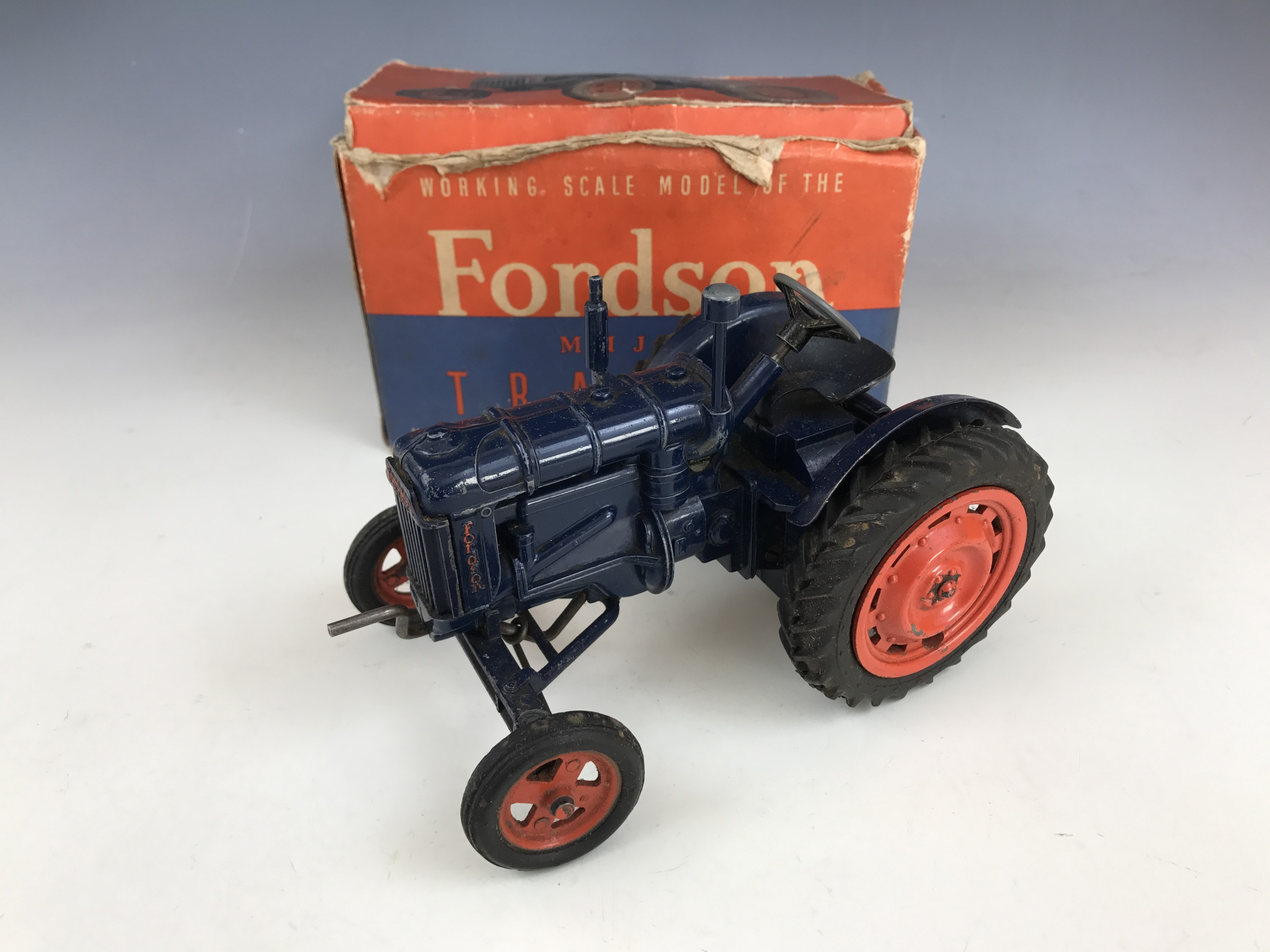 Lot 57 - A Chad Valley Co Ltd Working Scale Model of the New Fordson Major tractor, in navy blue with red