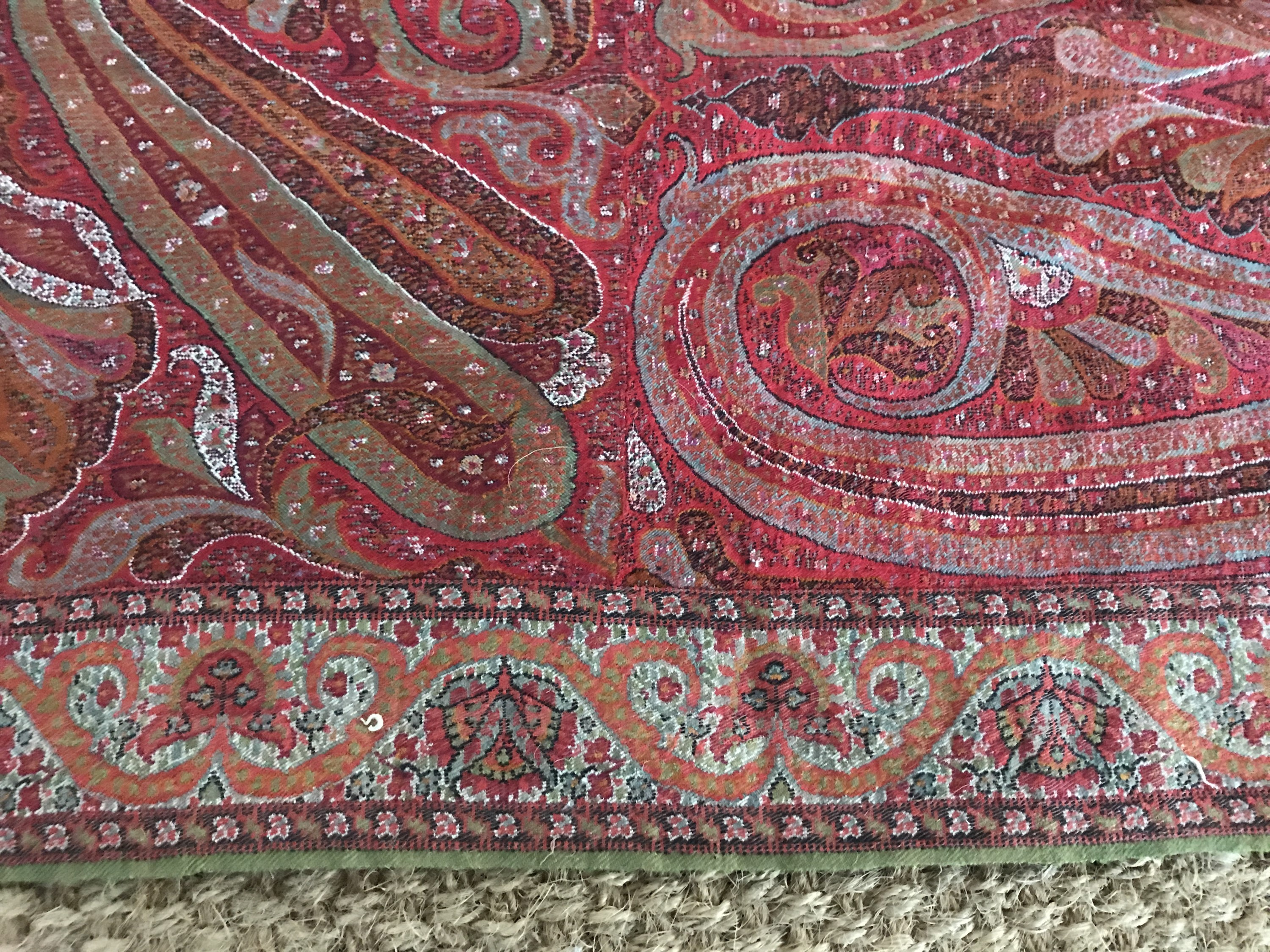 Lot 39 - A 19th Century woven paisley shawl, of Indian origin, having central circular insert in cream