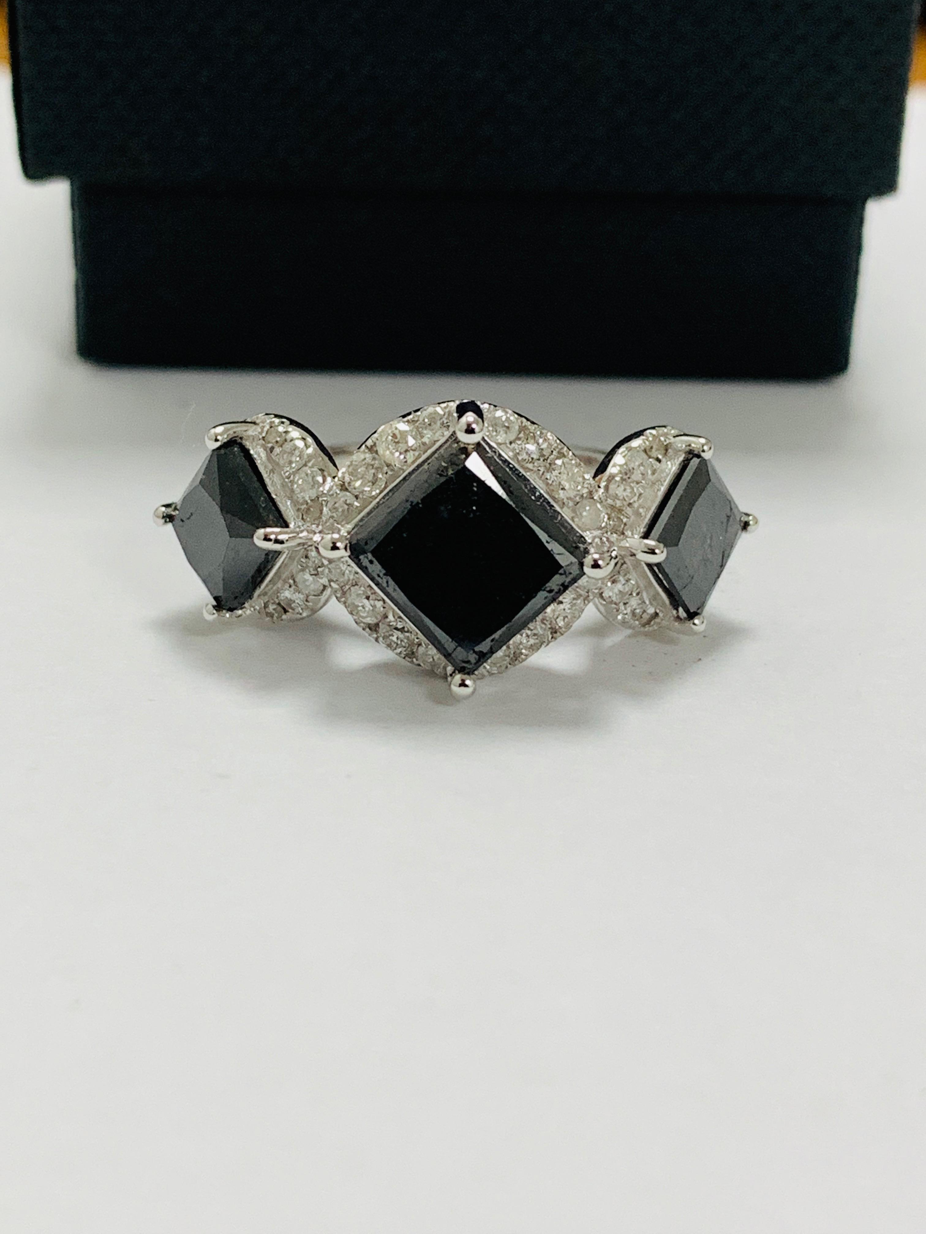 14ct white gold black diamond trilogy ring.