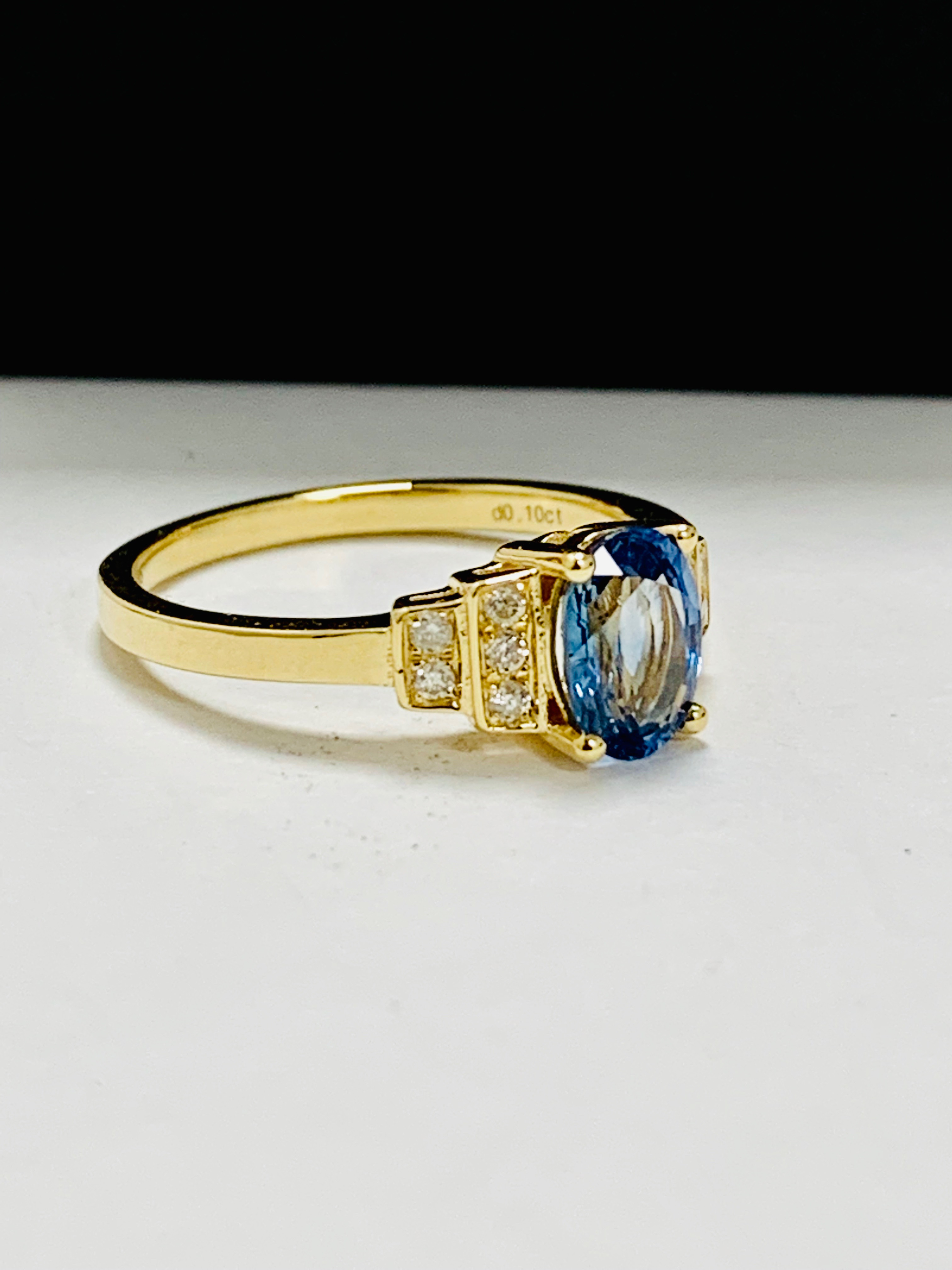 Lot 34 - 14ct yellow gold sapphire and diamond ring.