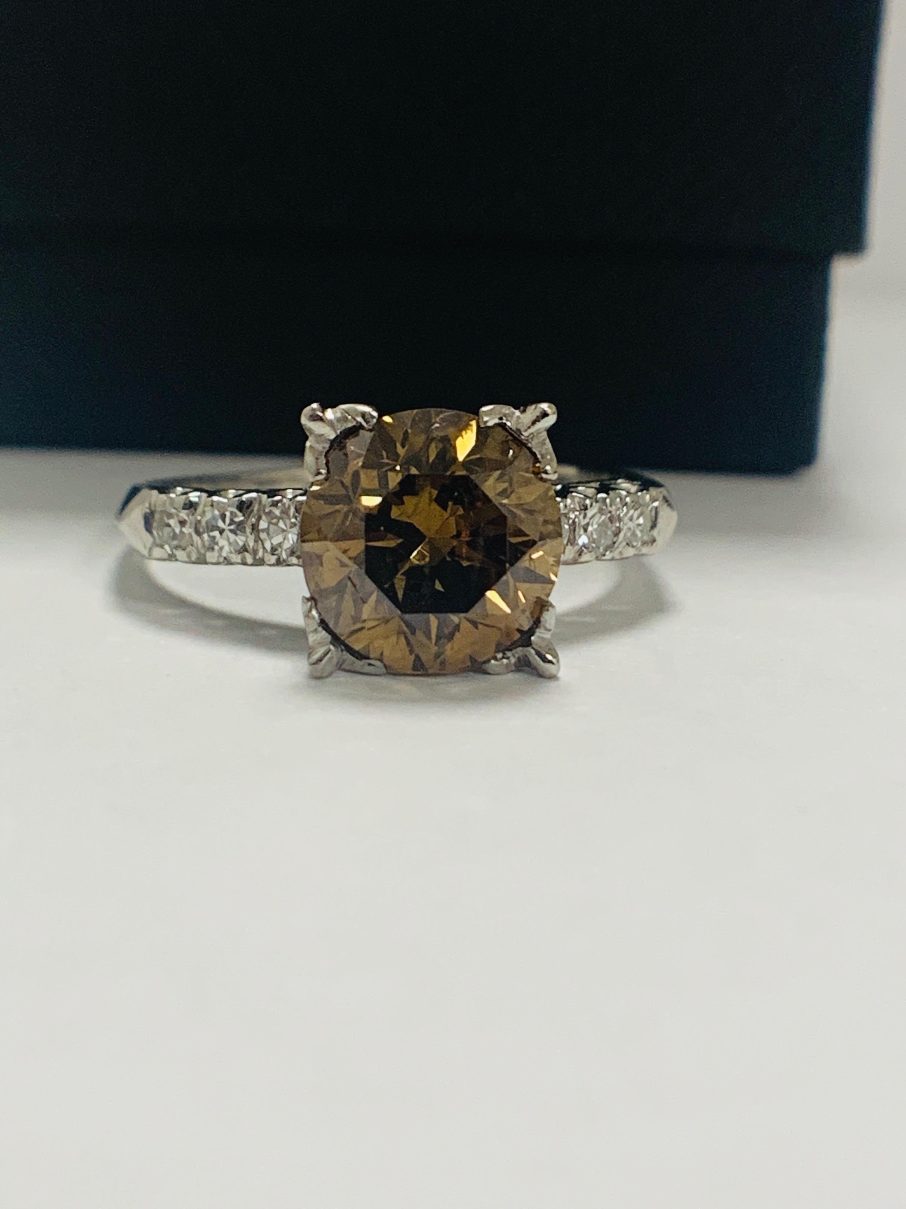 Platinum Diamond ring featuring centre, round brilliant cut, medium yellowish brown Diamond (3.20ct)