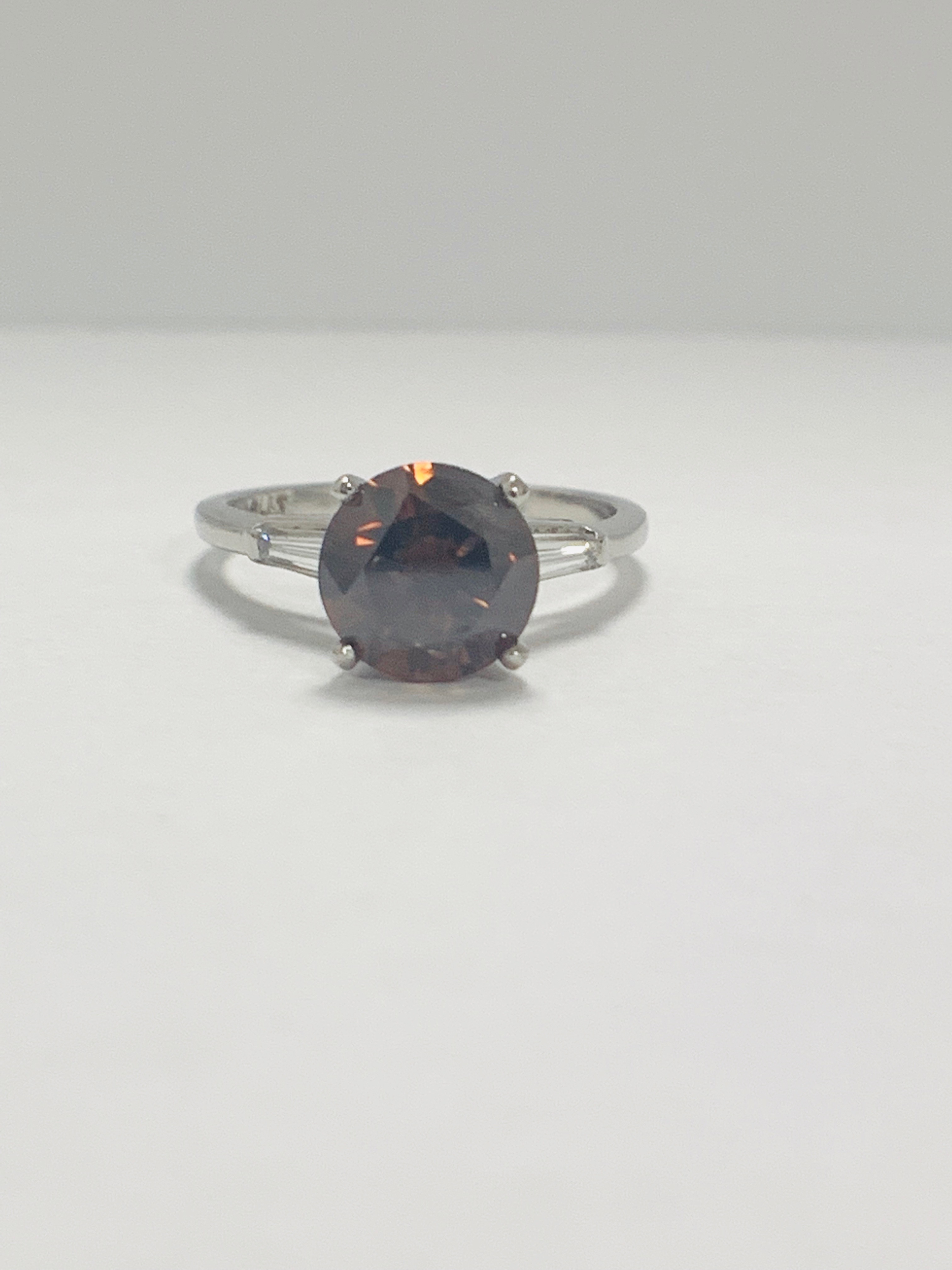 Platinum Diamond ring featuring centre, round brilliant cut, deep orangey brown Diamond (2.15ct)