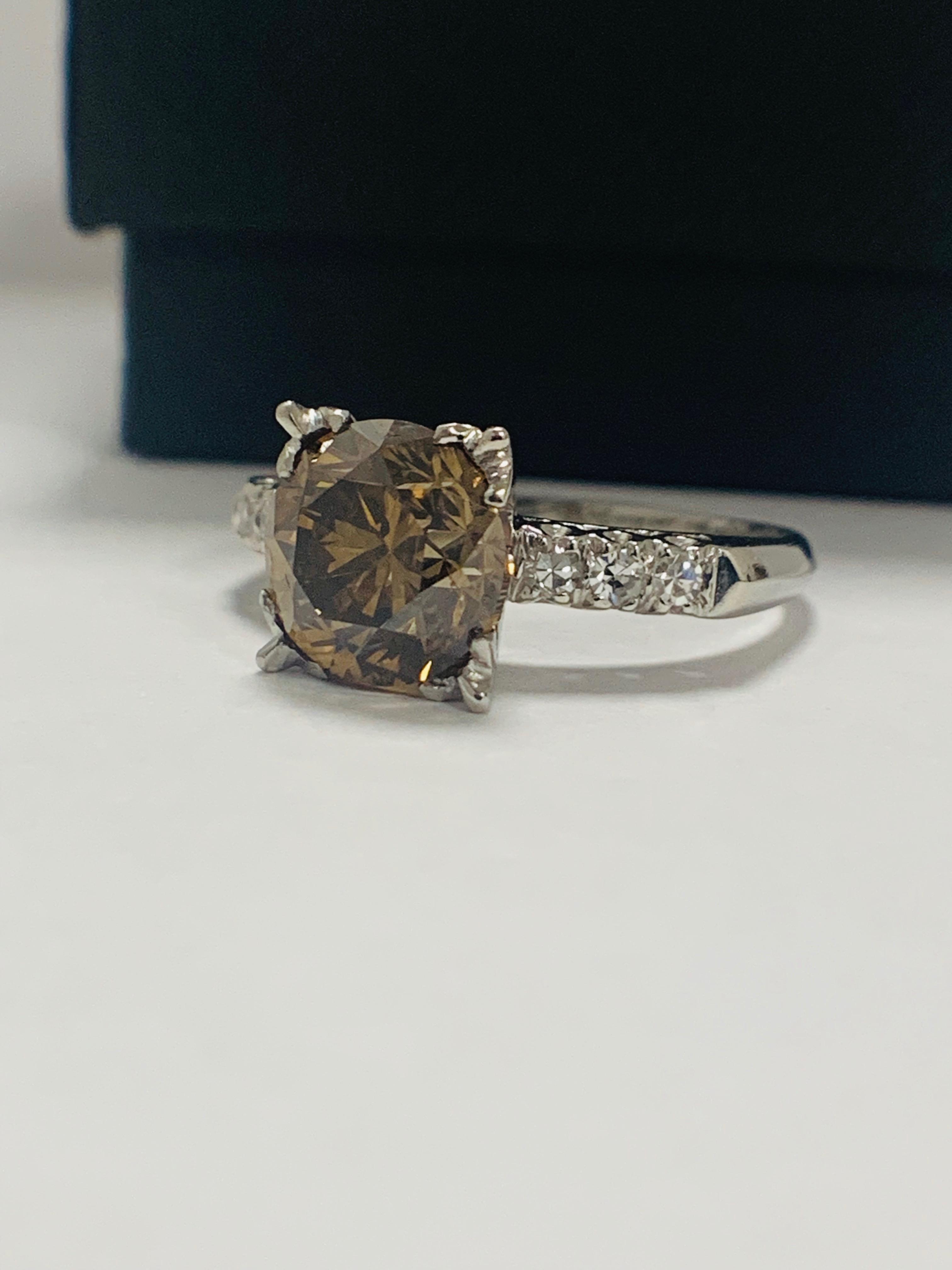 Platinum Diamond ring featuring centre, round brilliant cut, medium yellowish brown Diamond (3.20ct) - Image 2 of 9