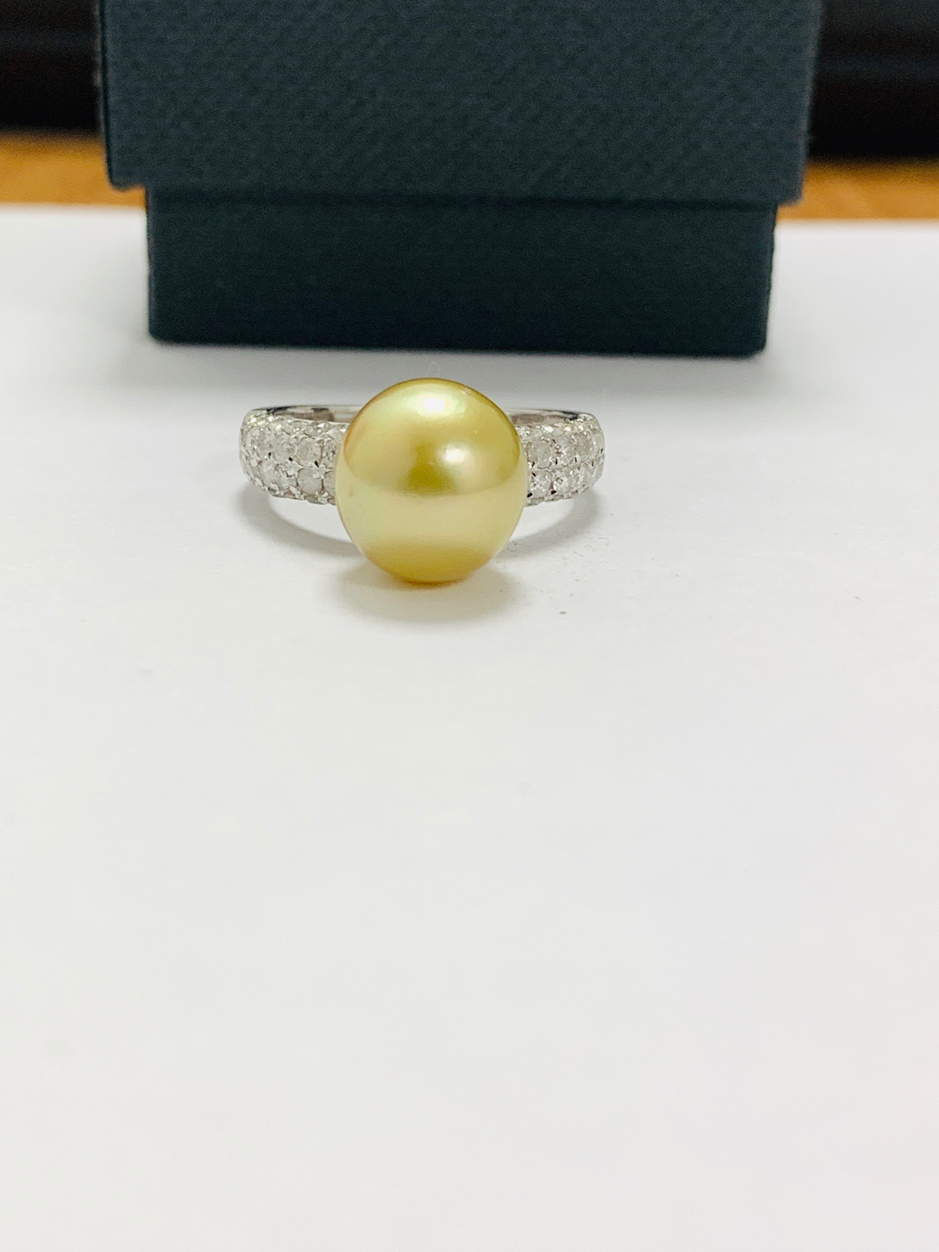 14ct white gold pearl & diamond ring.