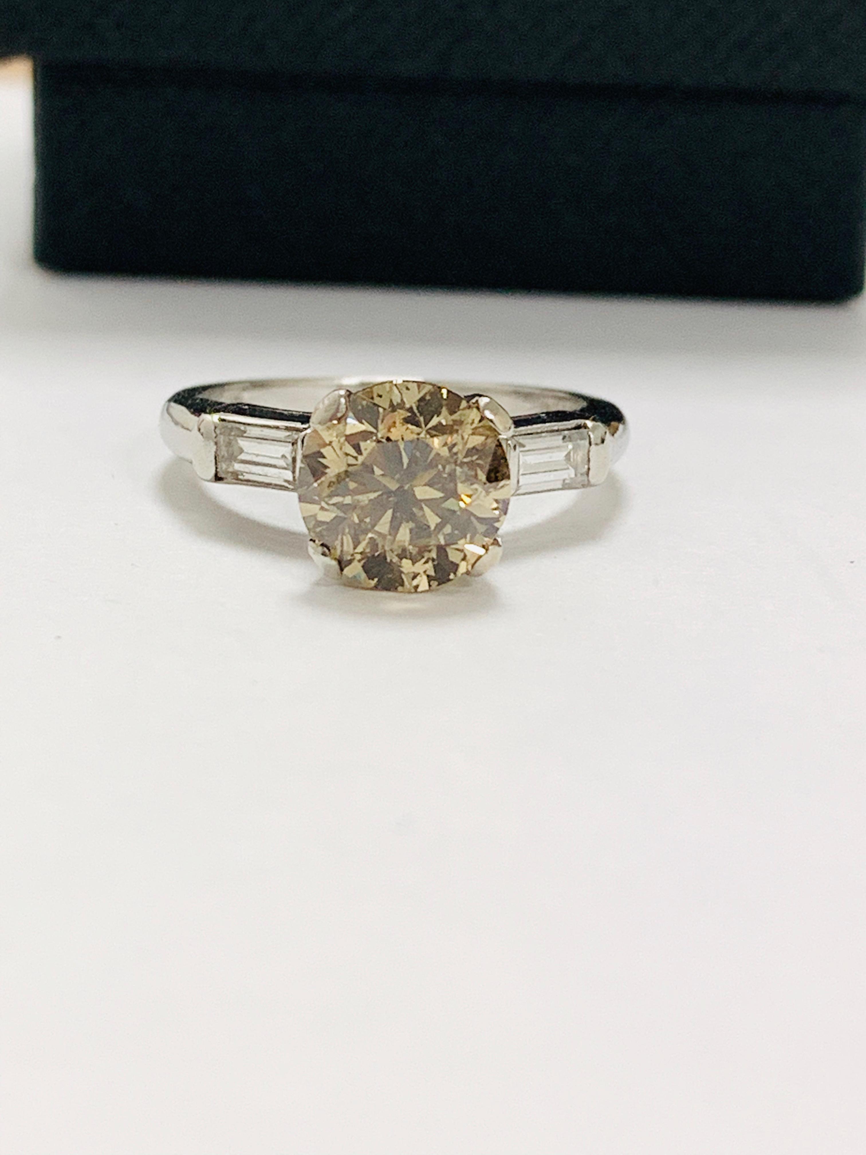 14ct white gold diamond ring.