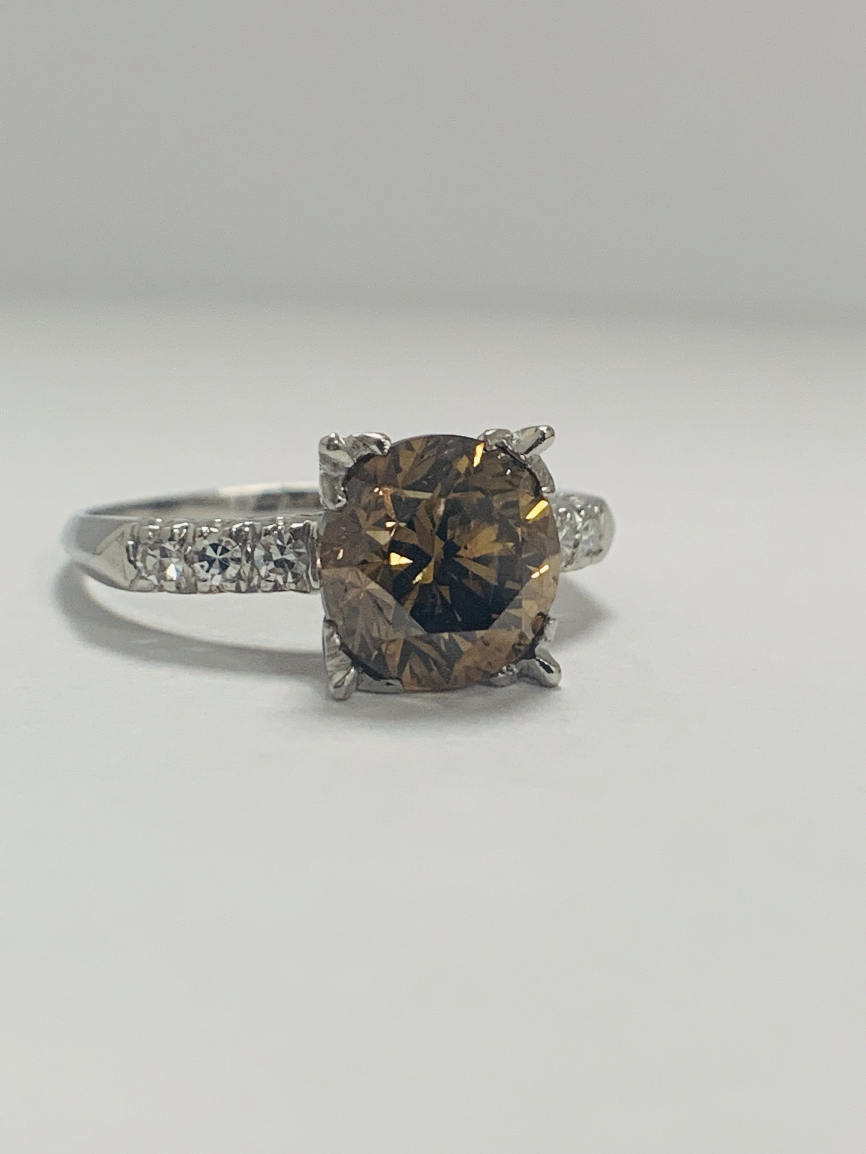 Platinum Diamond ring featuring centre, round brilliant cut, medium yellowish brown Diamond (3.20ct) - Image 8 of 9