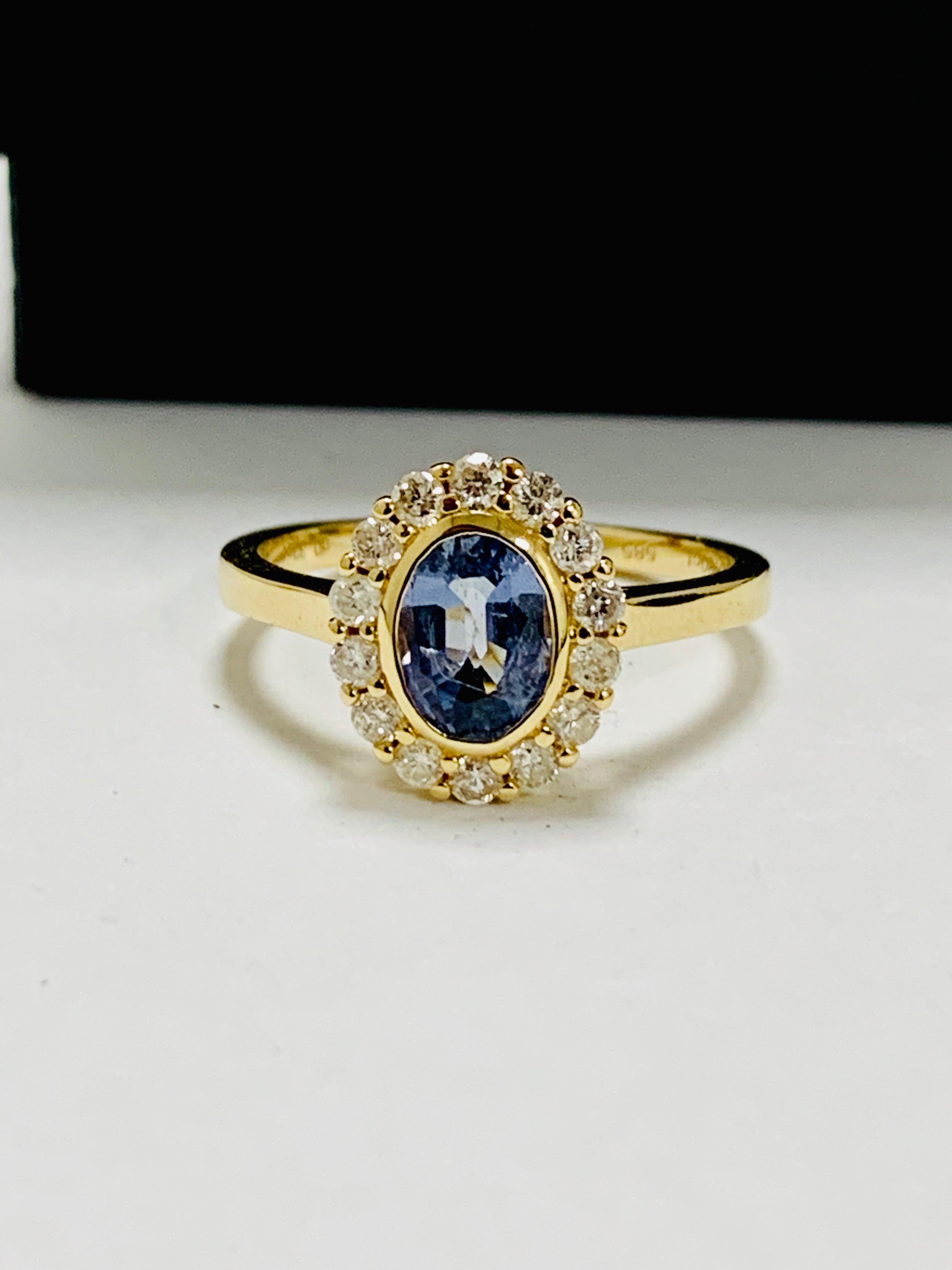 14ct yellow gold sapphire and diamond ring.