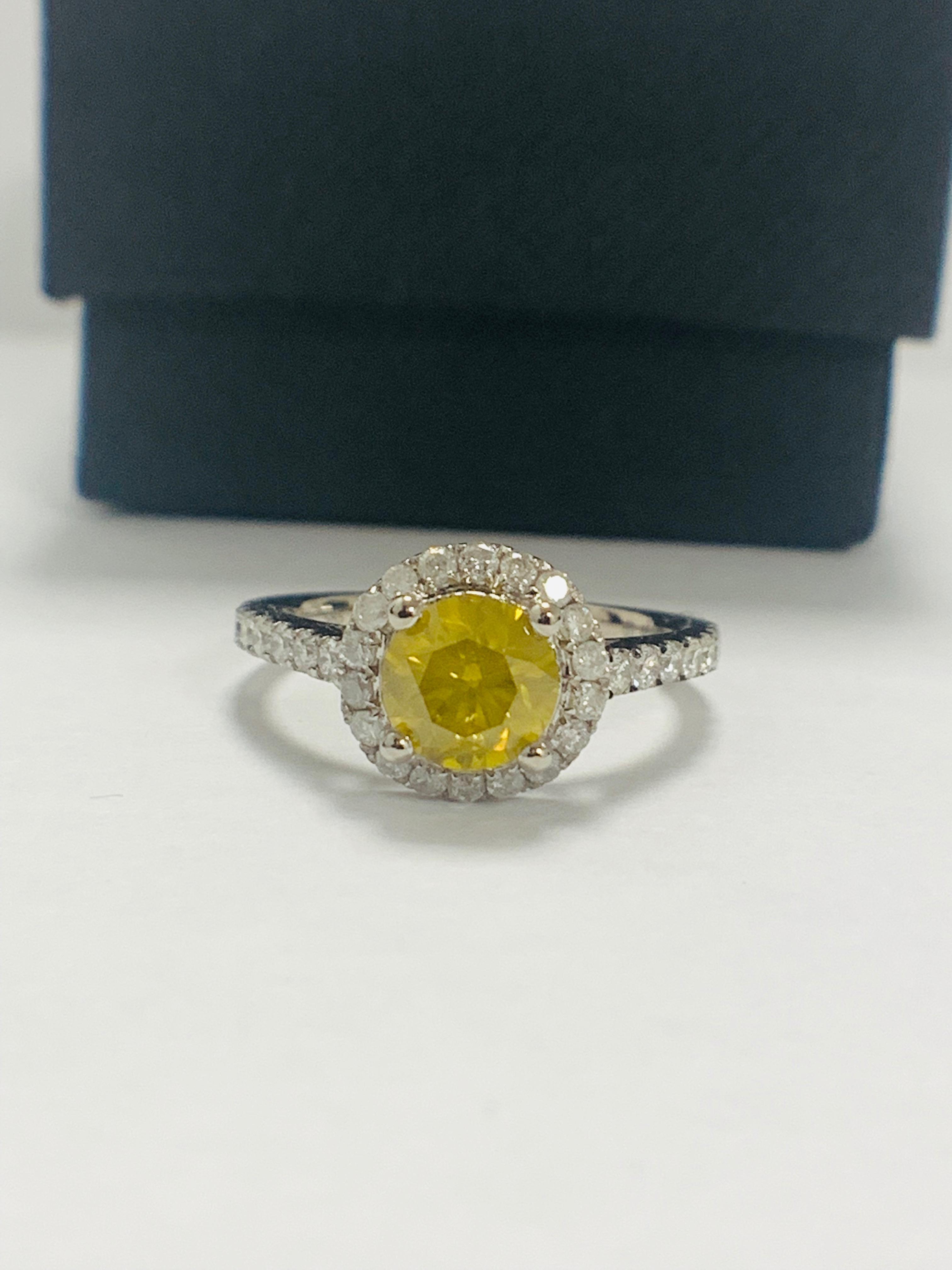 14ct White Gold Diamond ring featuring centre, round brilliant cut, yellow Diamond (1.08ct)