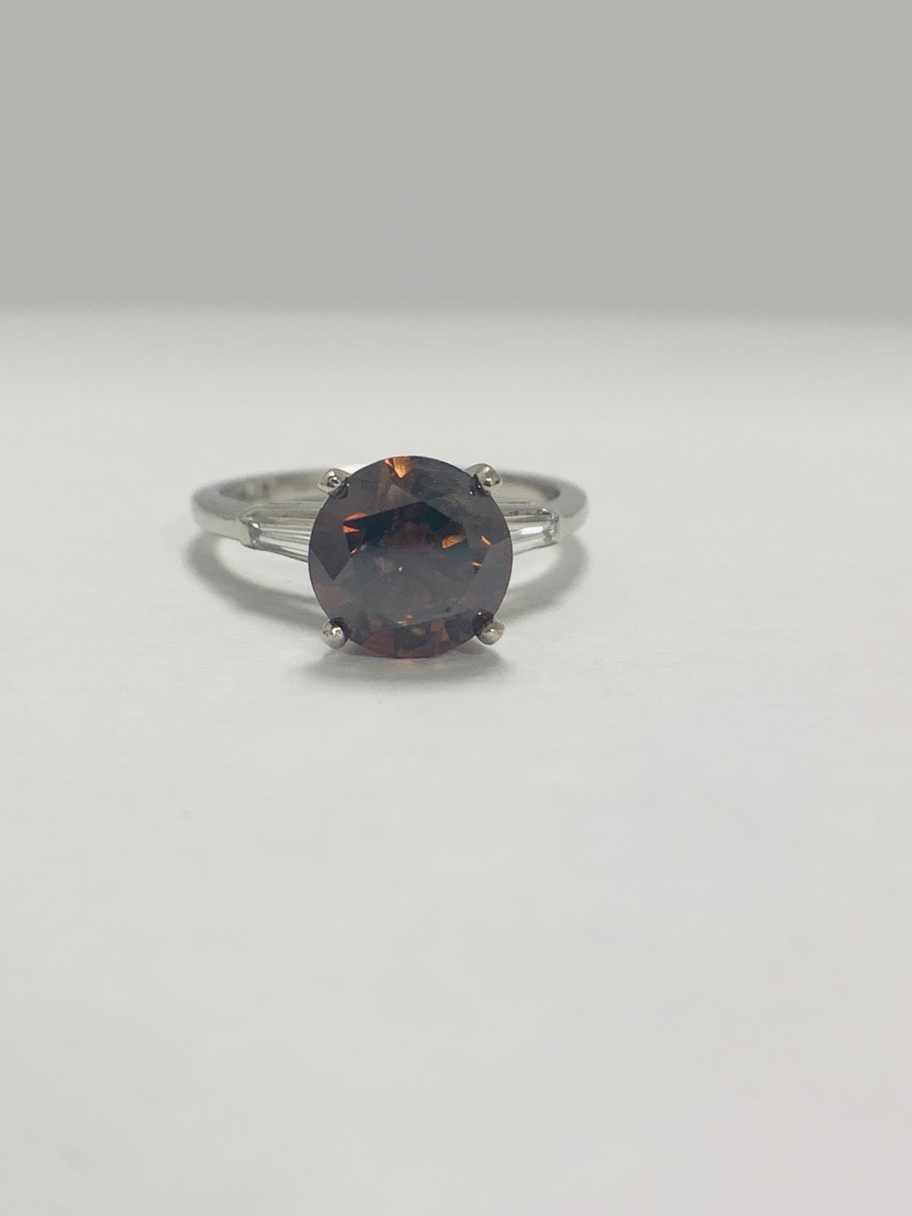 Platinum Diamond ring featuring centre, round brilliant cut, deep orangey brown Diamond (2.15ct) - Image 2 of 14