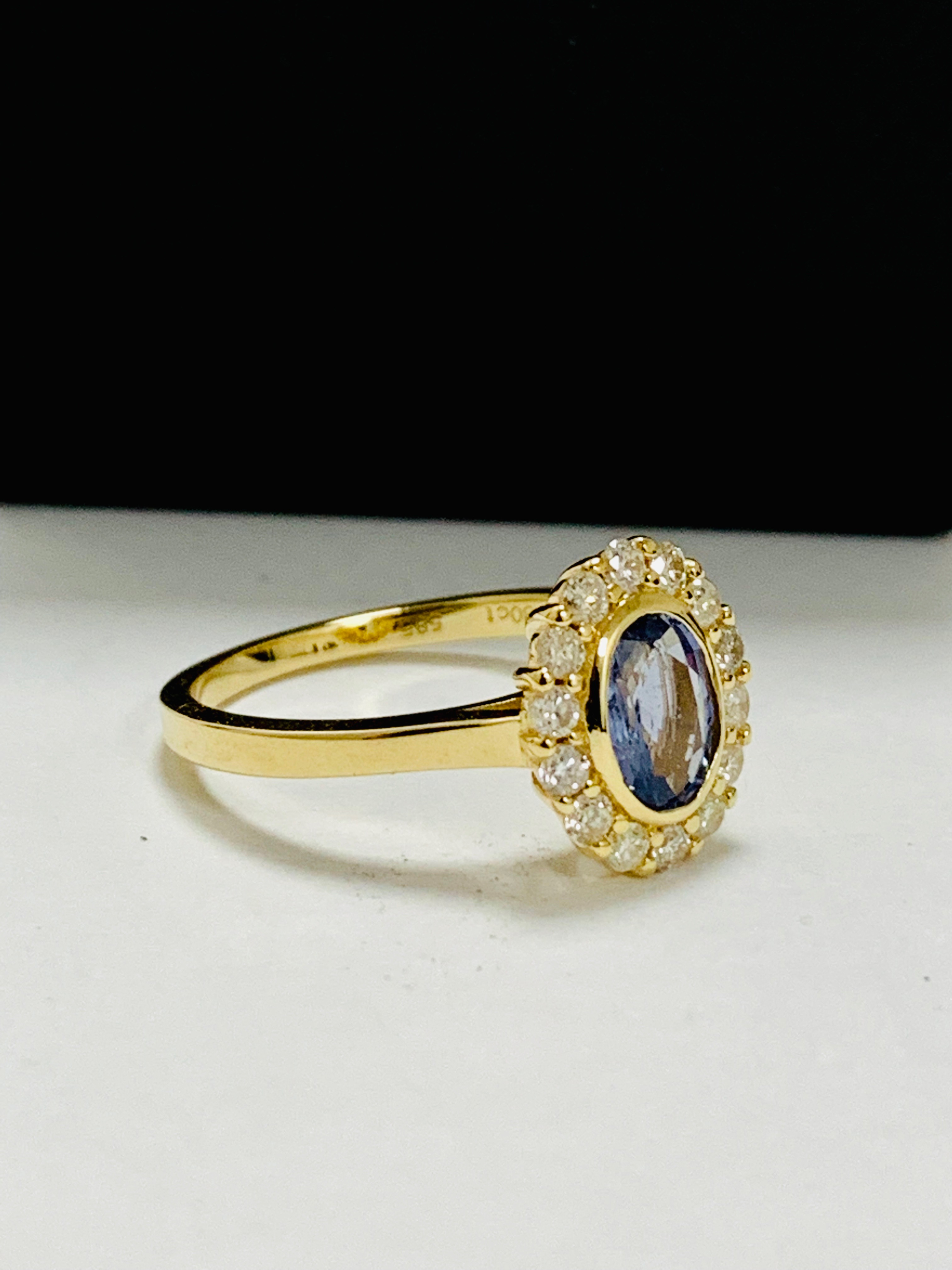 14ct yellow gold sapphire and diamond ring. - Image 8 of 11