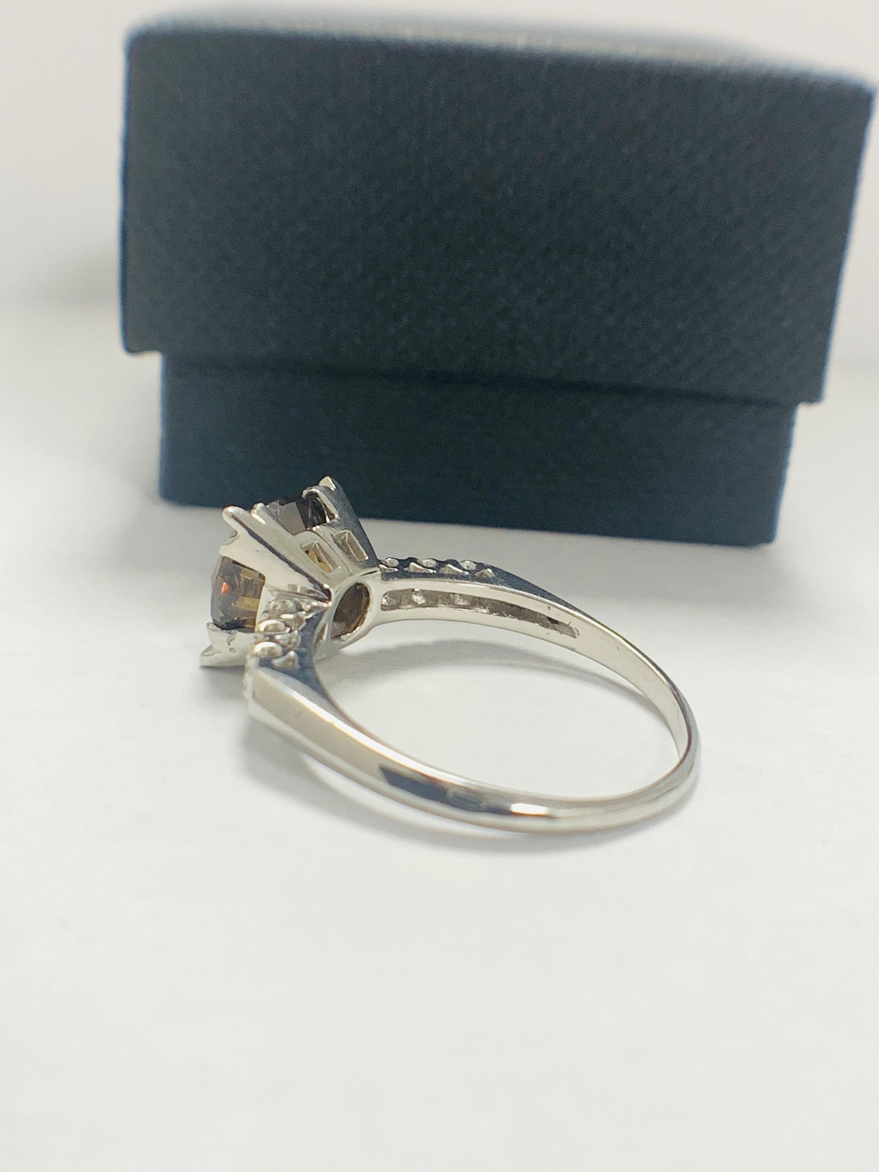 Platinum Diamond ring featuring centre, round brilliant cut, medium yellowish brown Diamond (3.20ct) - Image 4 of 9